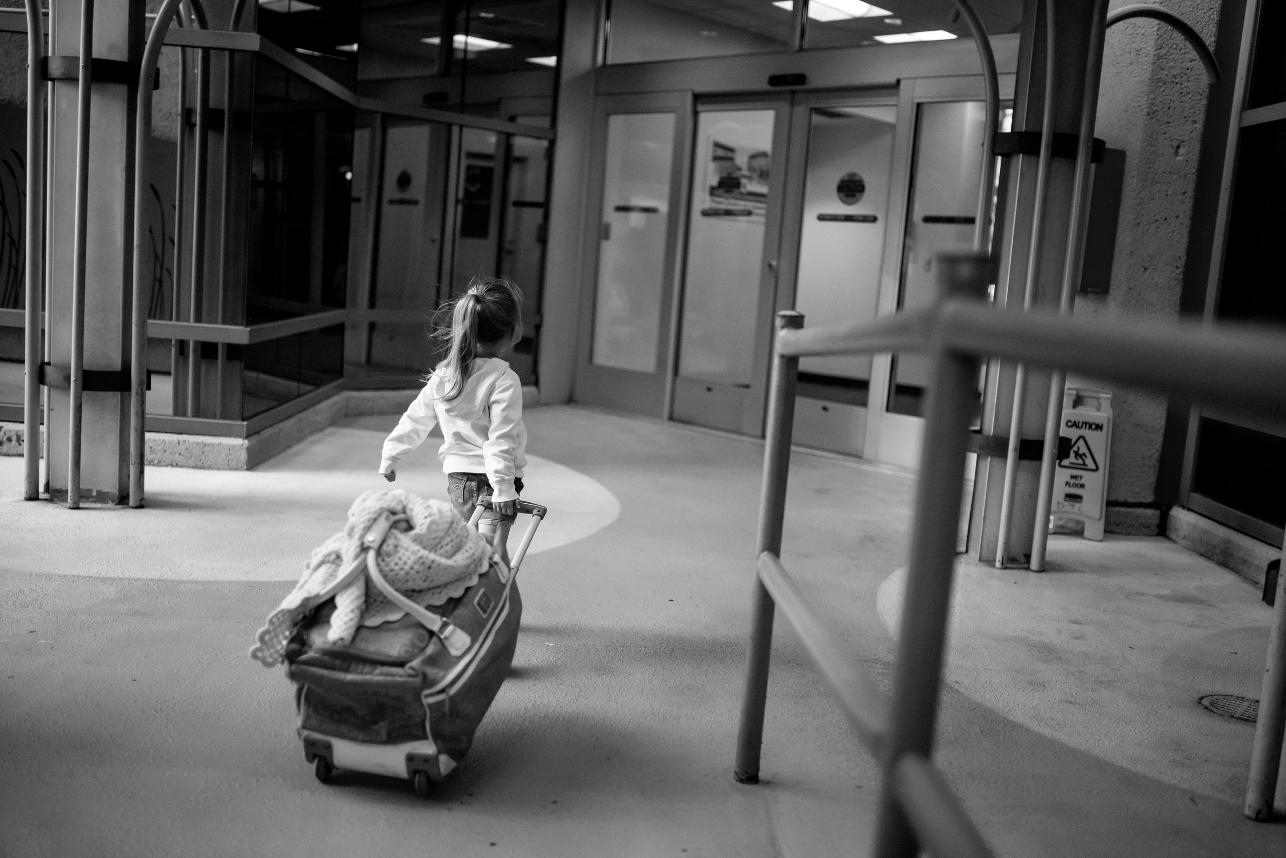 Girl with suitcase enters hospital for heart procedure