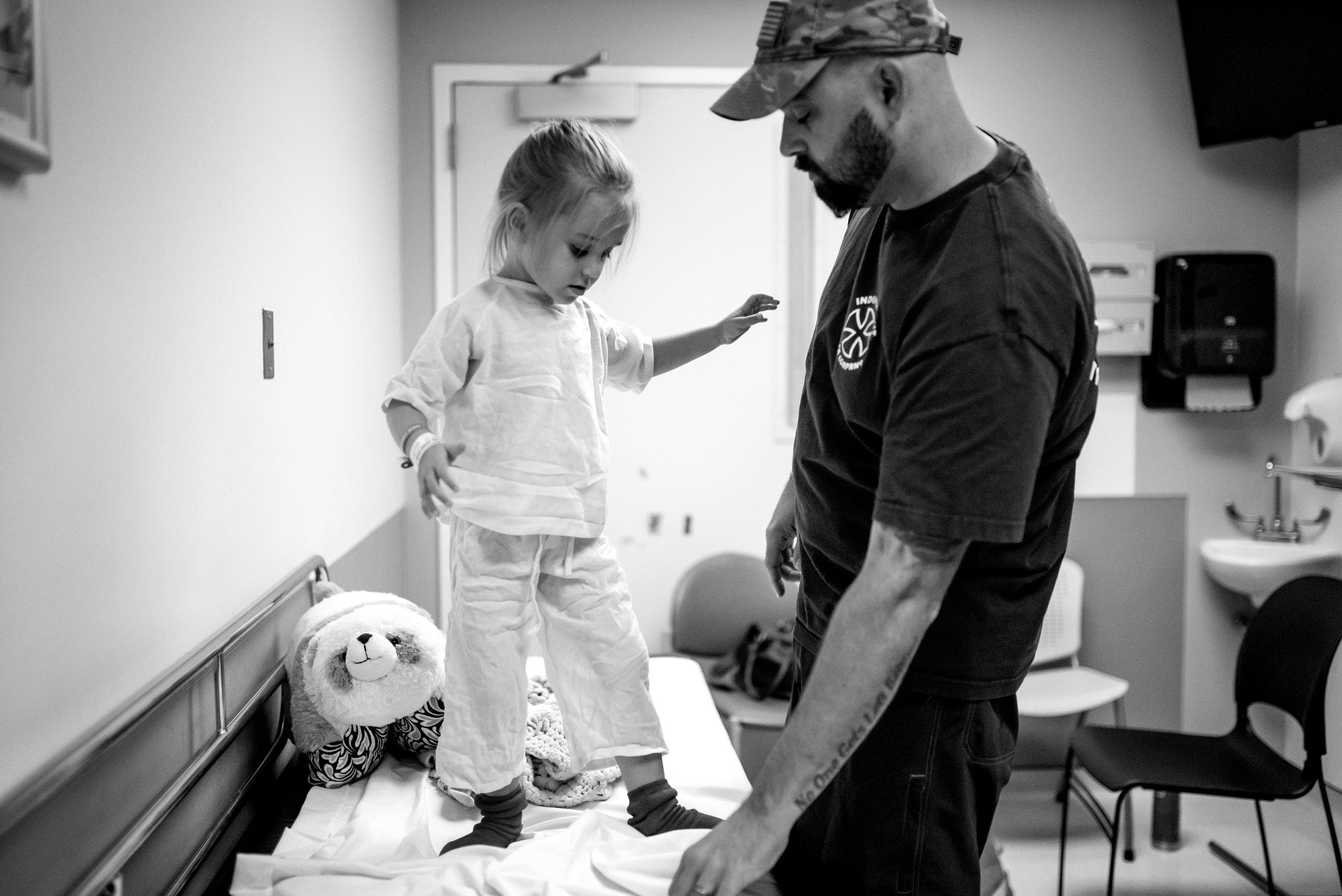 Heart procedure patient looks at slipper socks in surgery prep