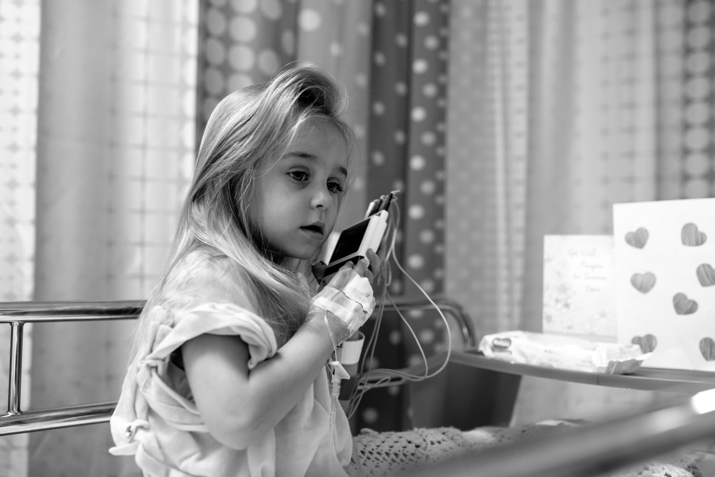 Girl plays with EKG monitor after heart procedure