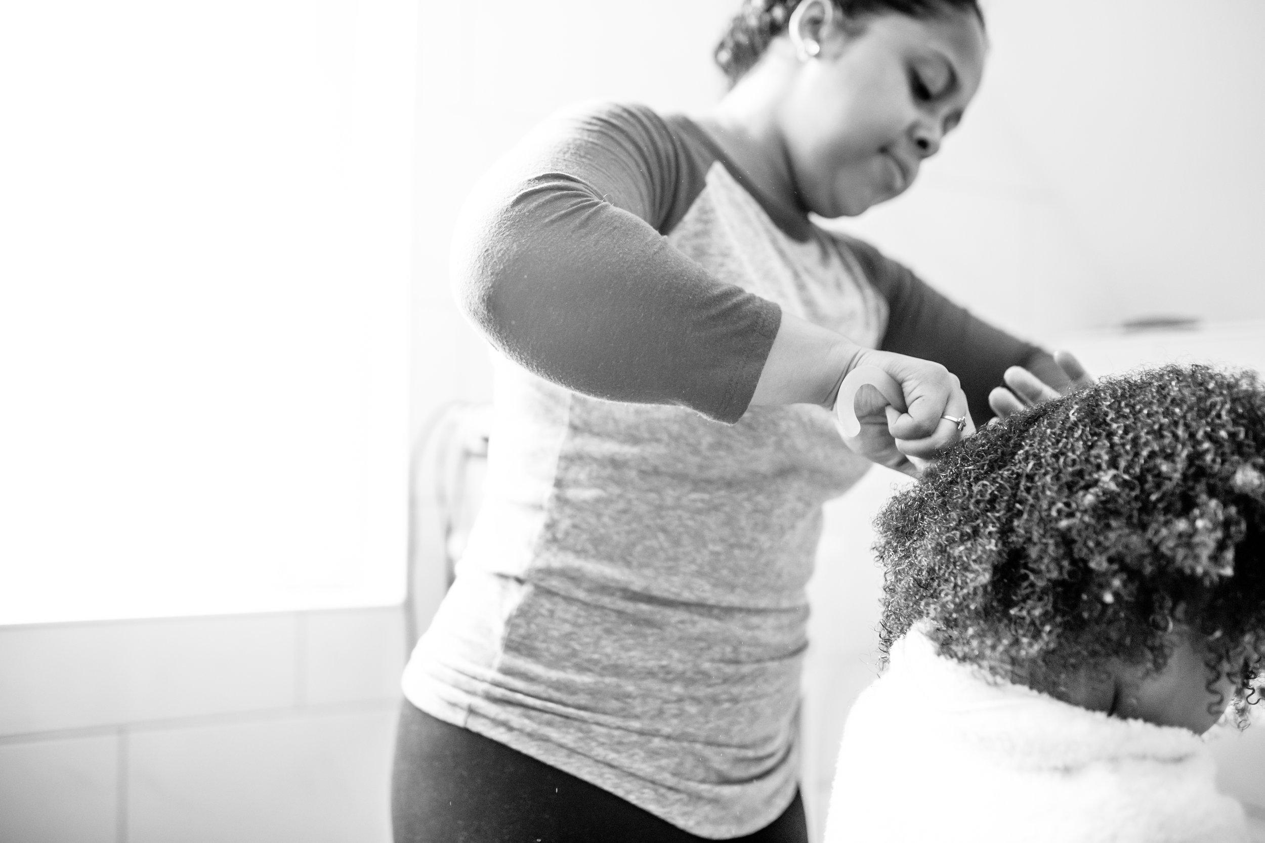 Mom brushes daughter's hair