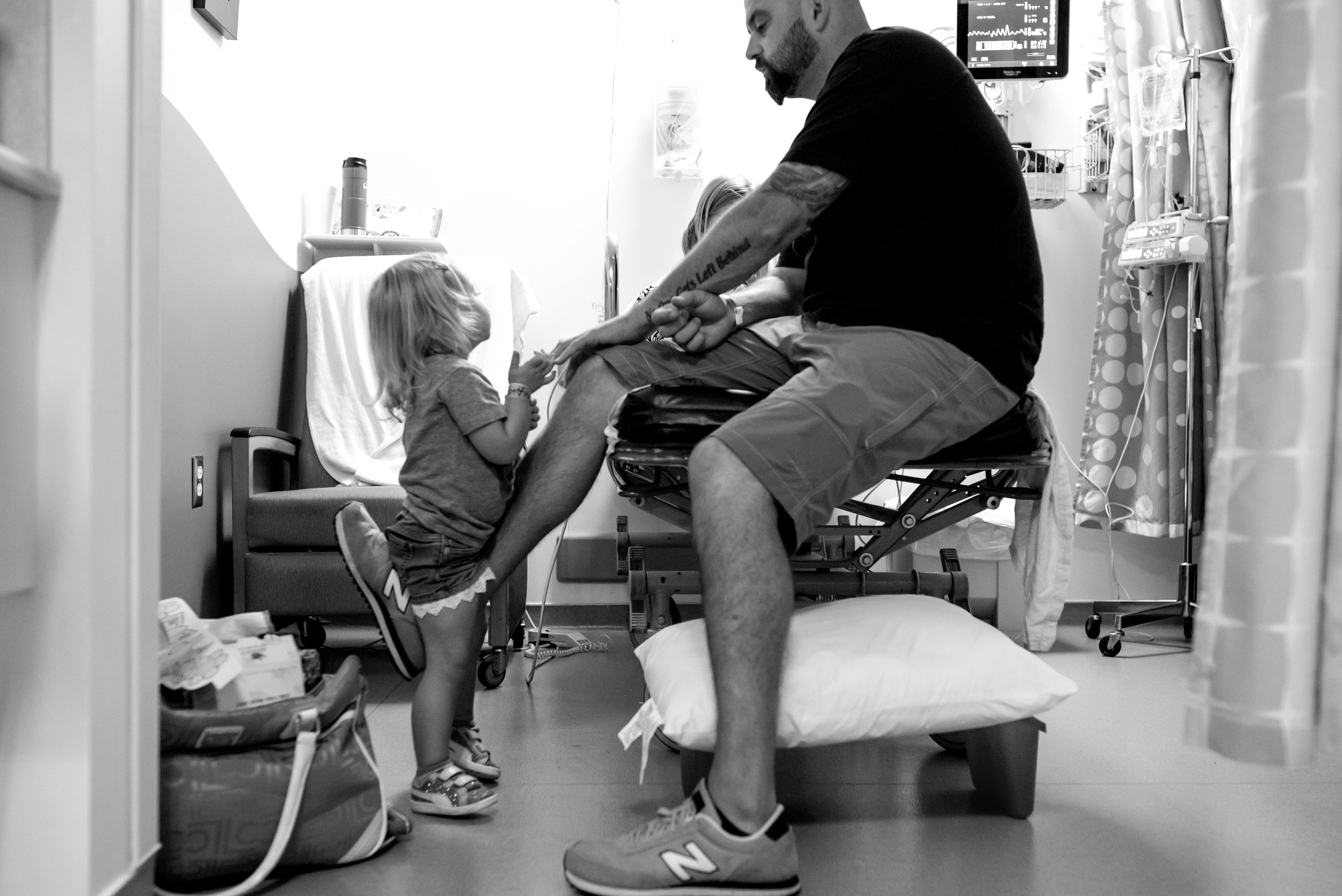 Dad plays with daughters in hospital