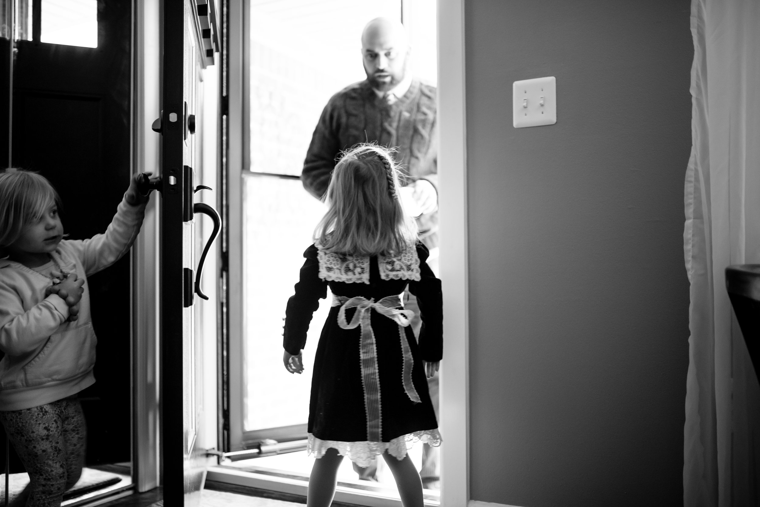 Fathers looks in awe upon daughter in doorway
