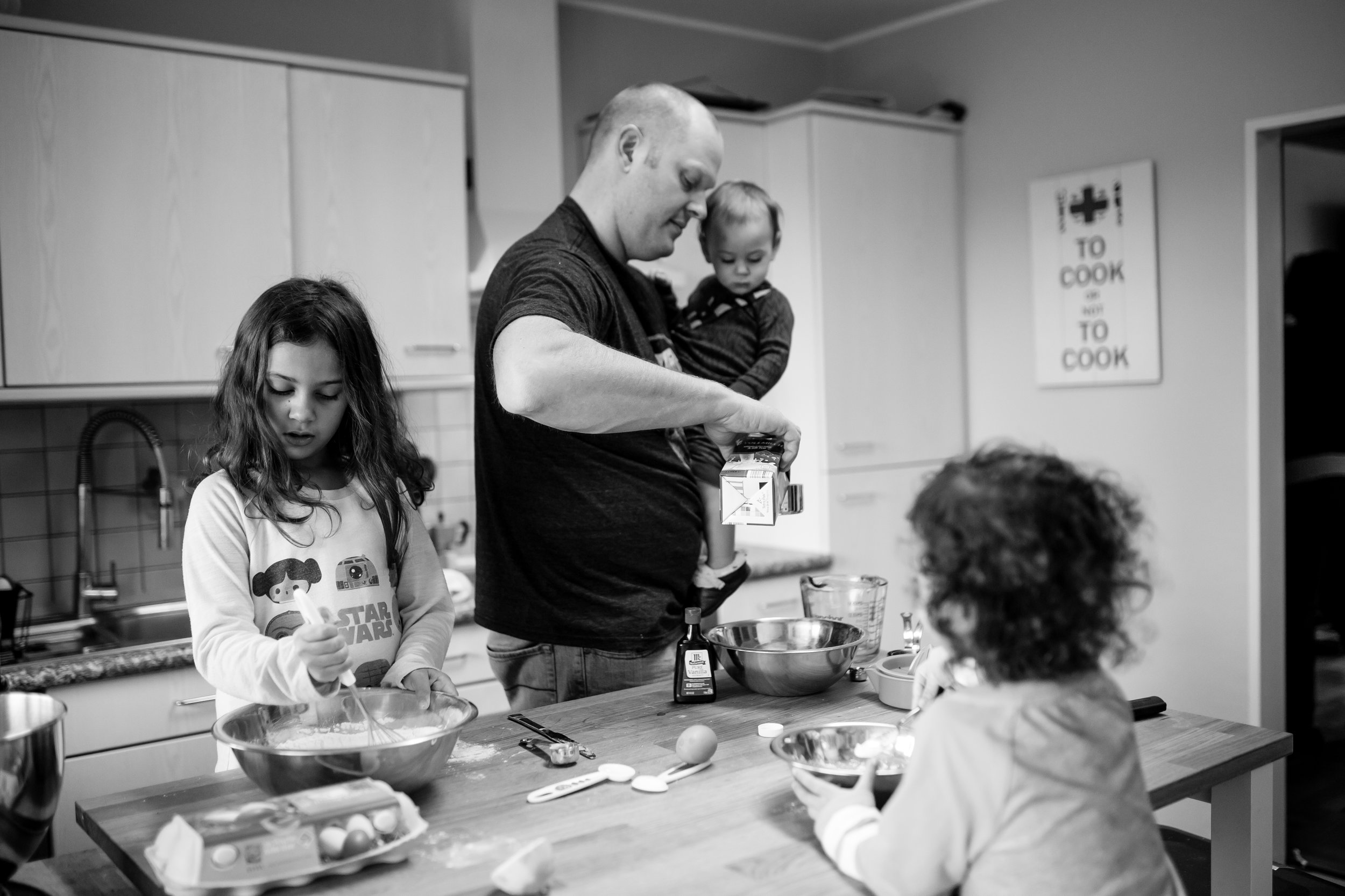 Dad and kids make pancakes together