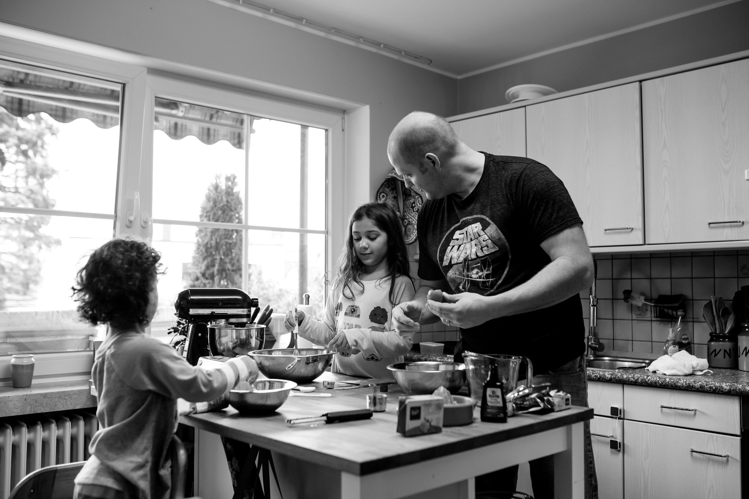 Dad and daughters talk and make pancakes