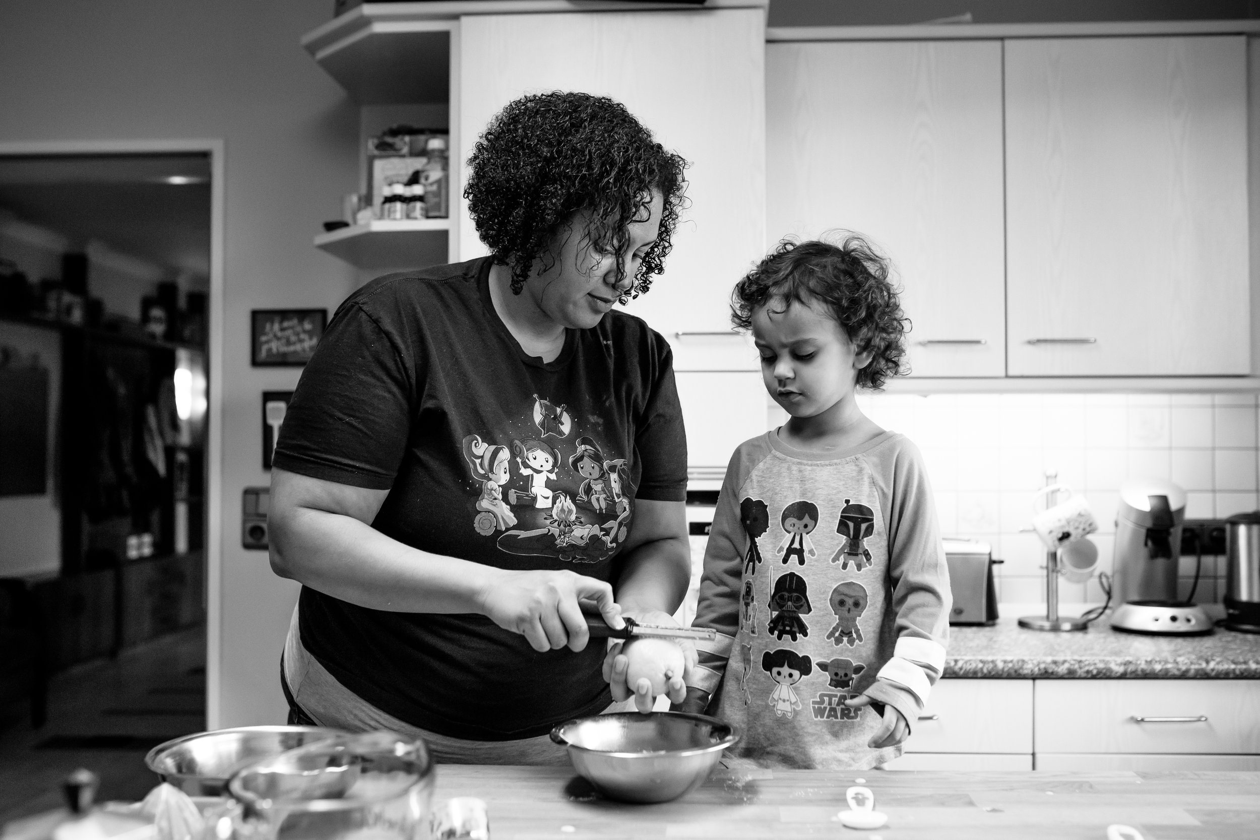 Mom shows daughter how to grate lemon peel