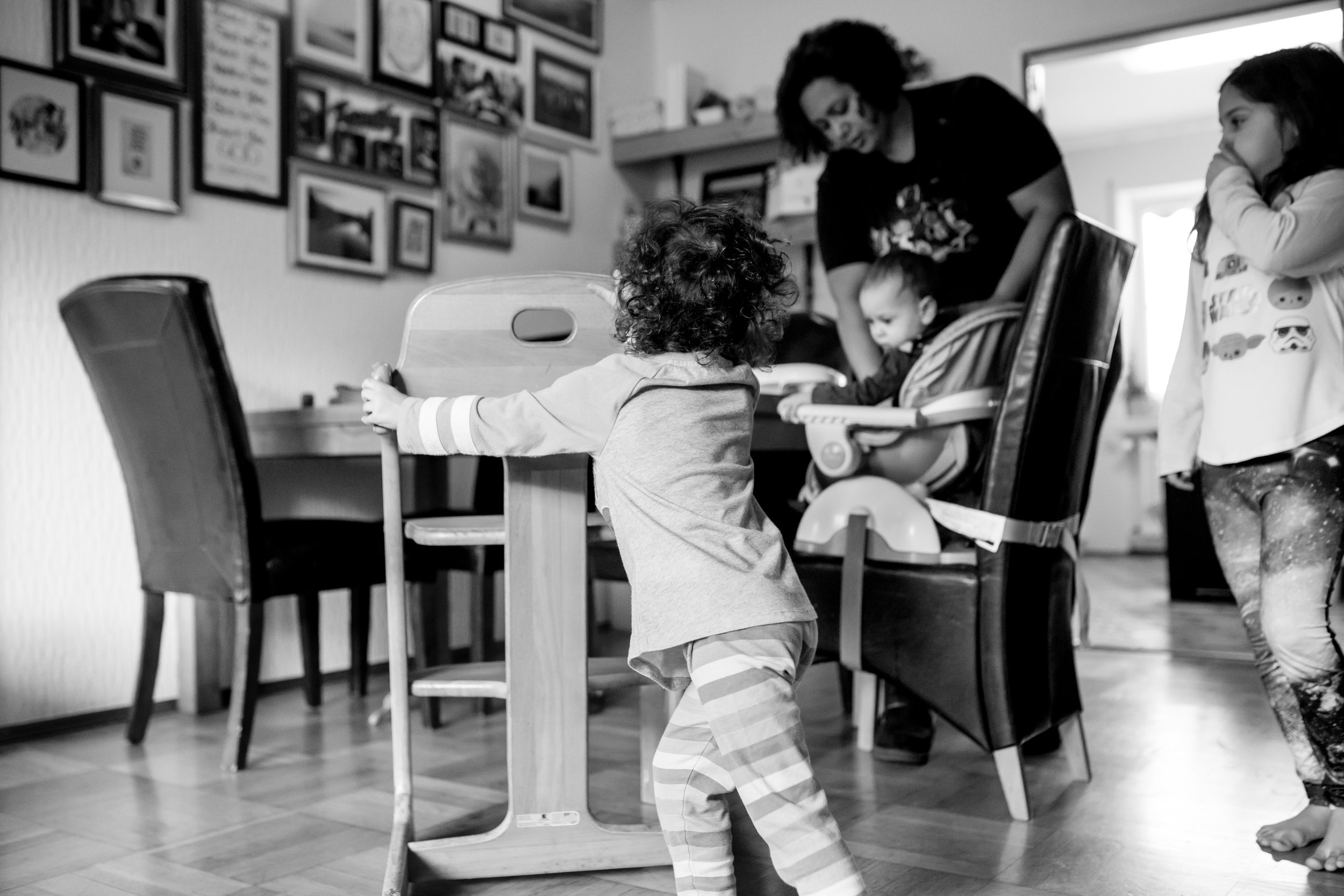Girl scoots high chair up to table
