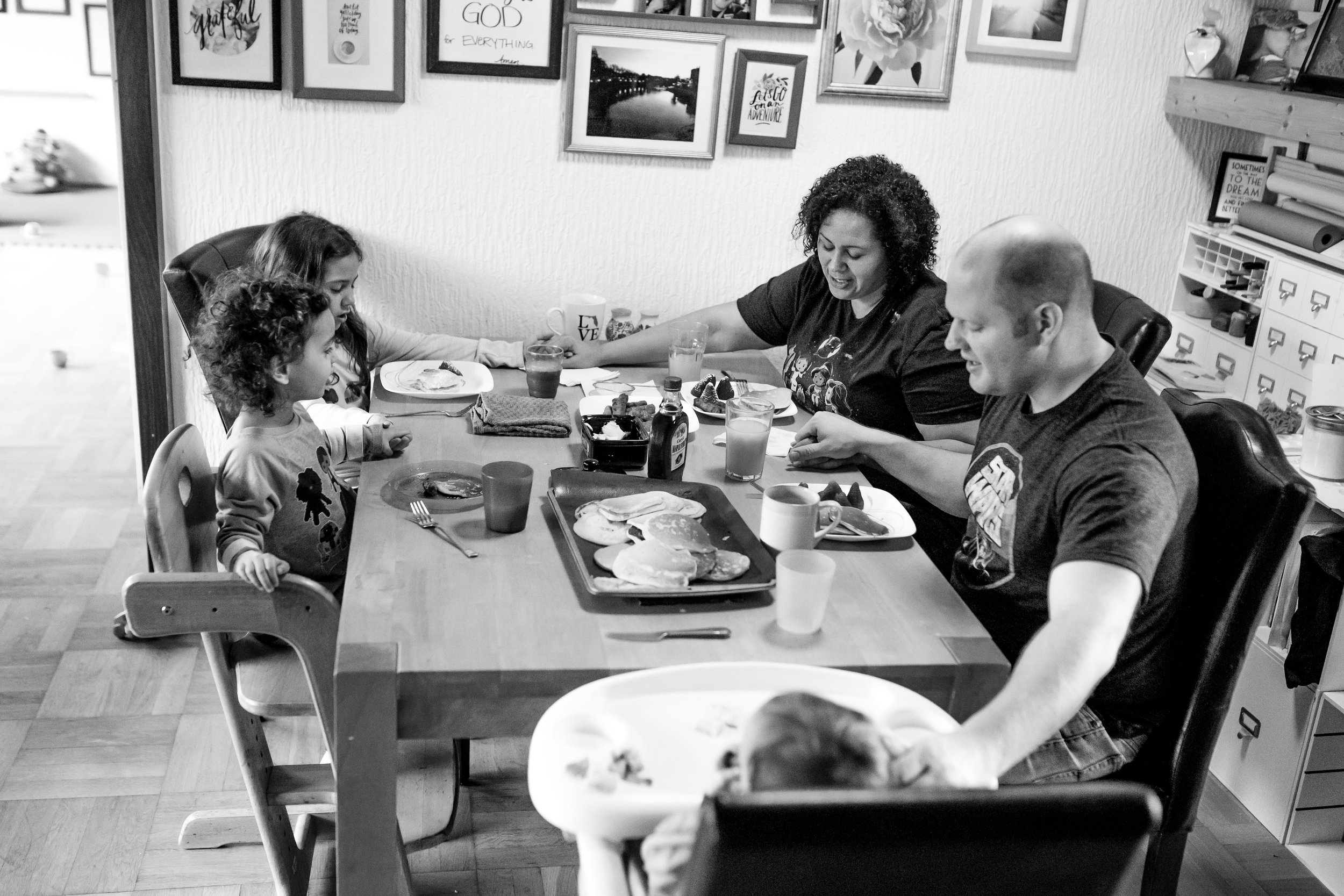 Family prays at table before meal
