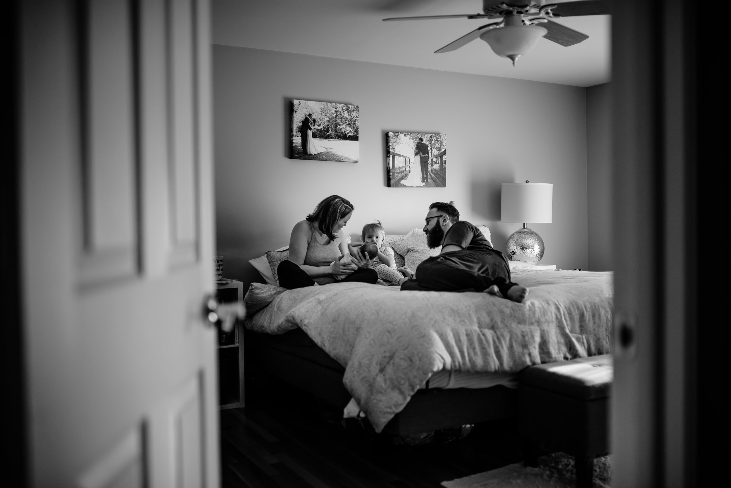 Family hangs out atop bed