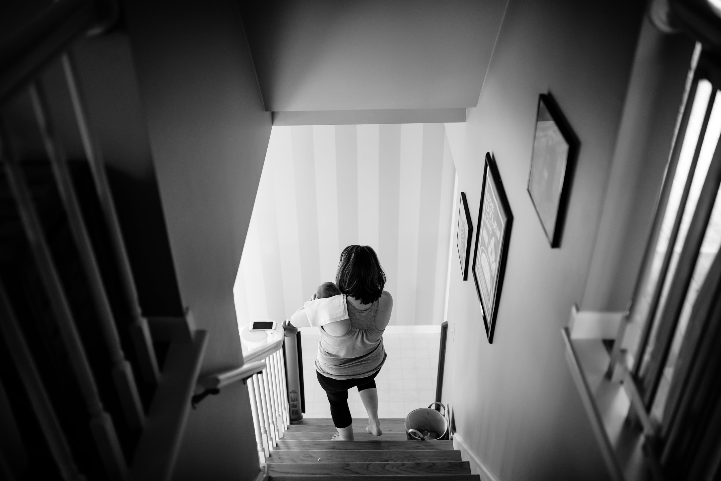 Mom carries baby down stairs