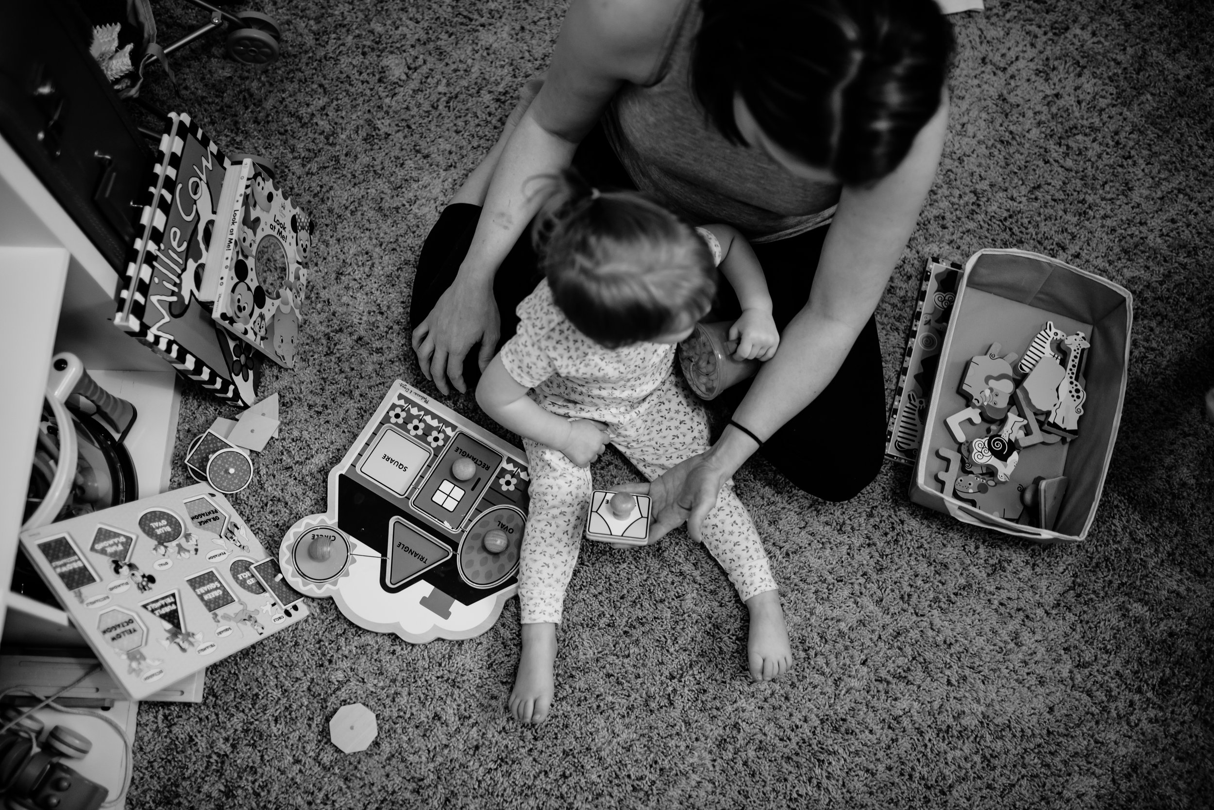 Mom and daughter play puzzles