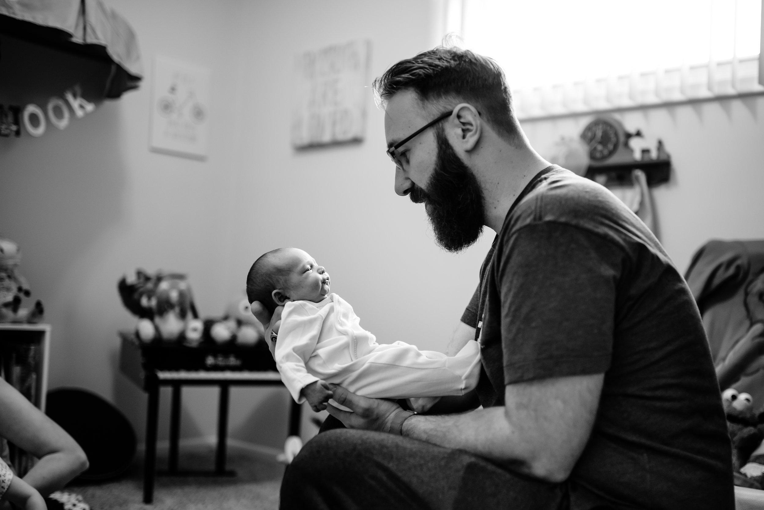 Dad admires baby