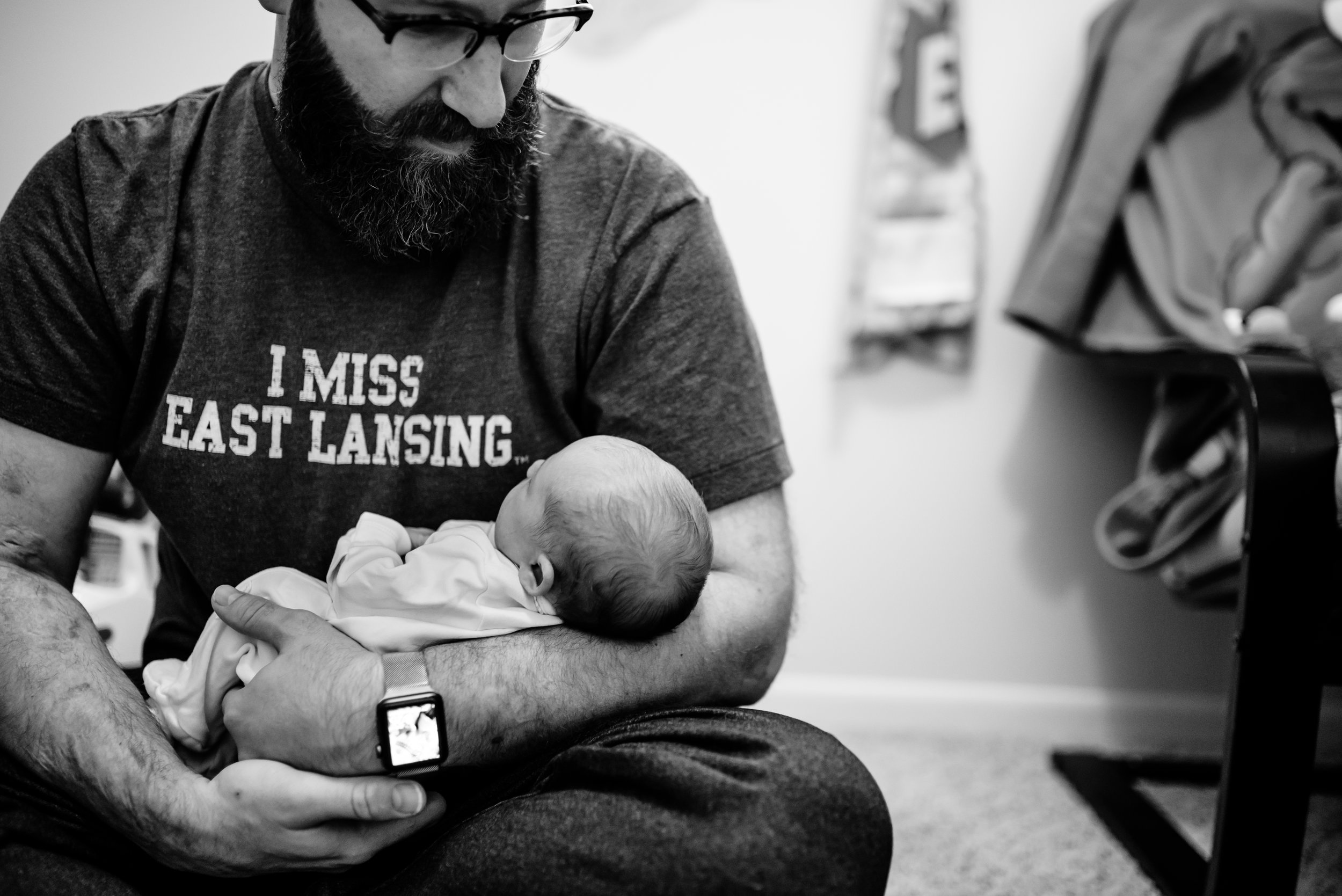 Dad admires baby as he holds her