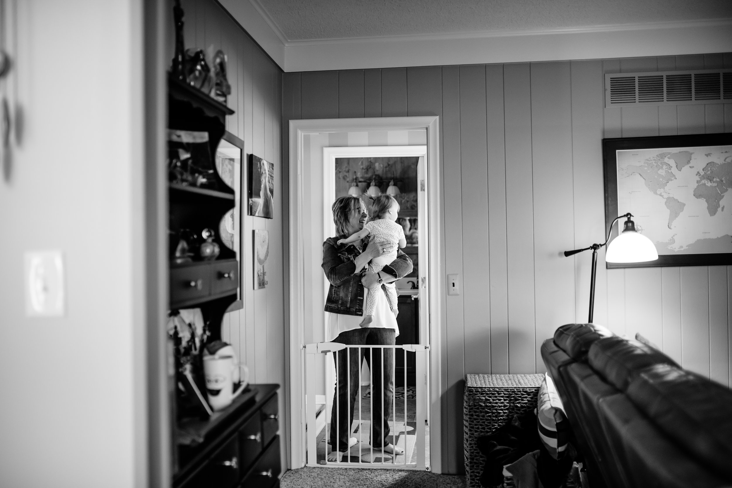 Grandma hugs girl in doorway