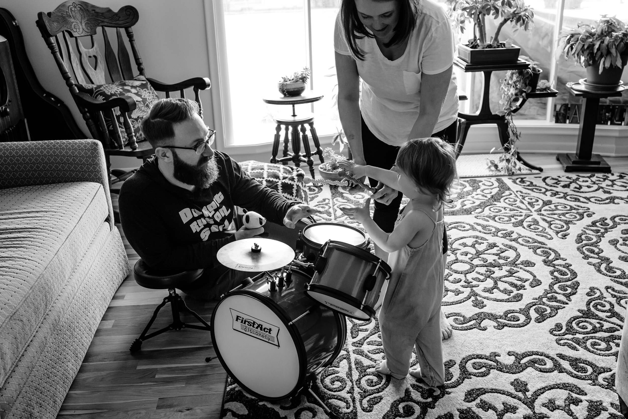 Mom and Dad play drums with daughter