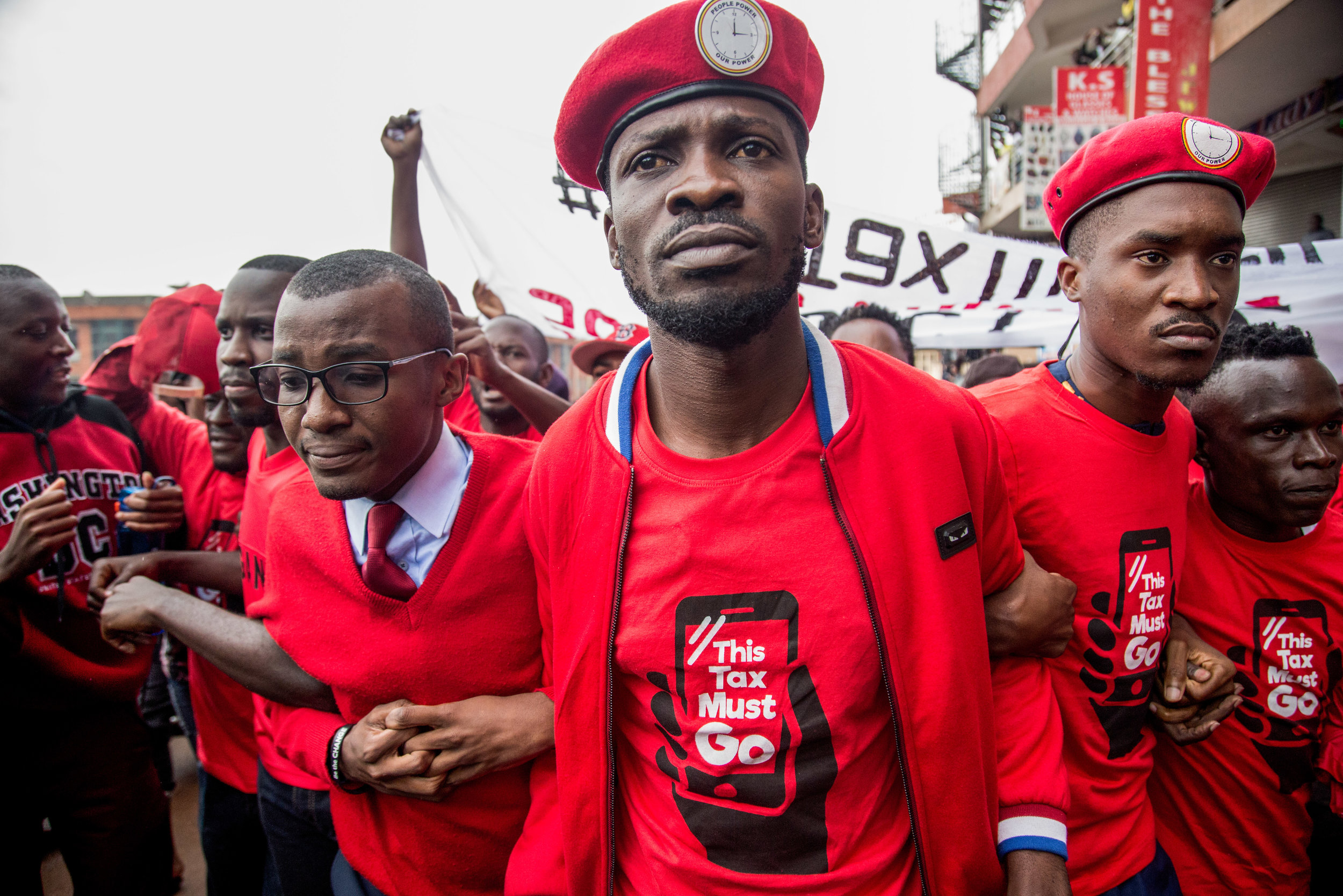 Opposition MP Bobi Wine and supporters protest the newly imposed social media tax in Kampala // AFP 07.2018