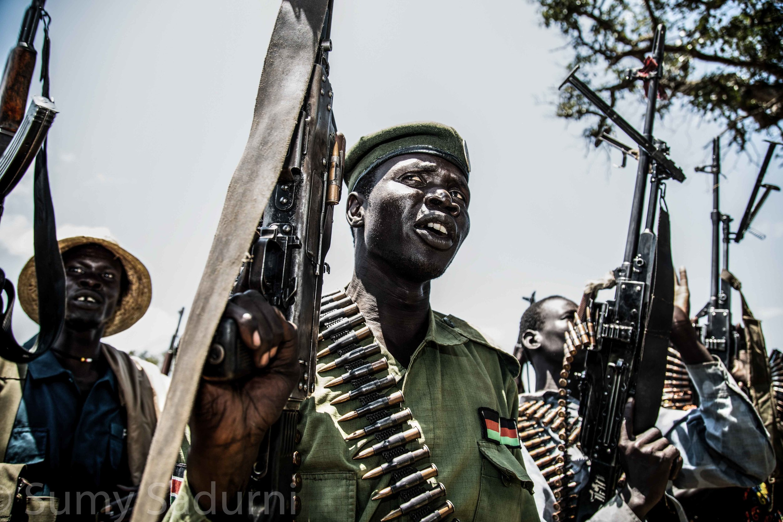 Print 2 : A rebel fighter from the Sudan People's Liberation Army - In Opposition (SPLA-IO) prepares to be deployed to the frontline in Panyume, South Sudan.