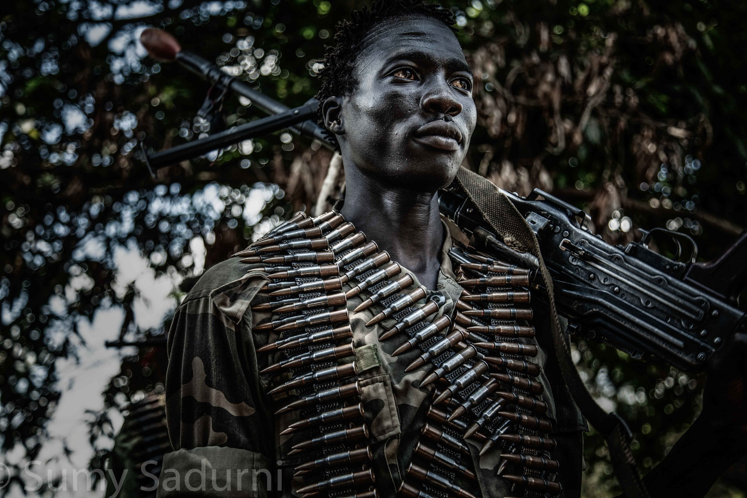 Print 4: A rebel fighter from the Sudan People's Liberation Army - In Opposition (SPLA-IO) prepares to be deployed to the frontline in Panyume, South Sudan.