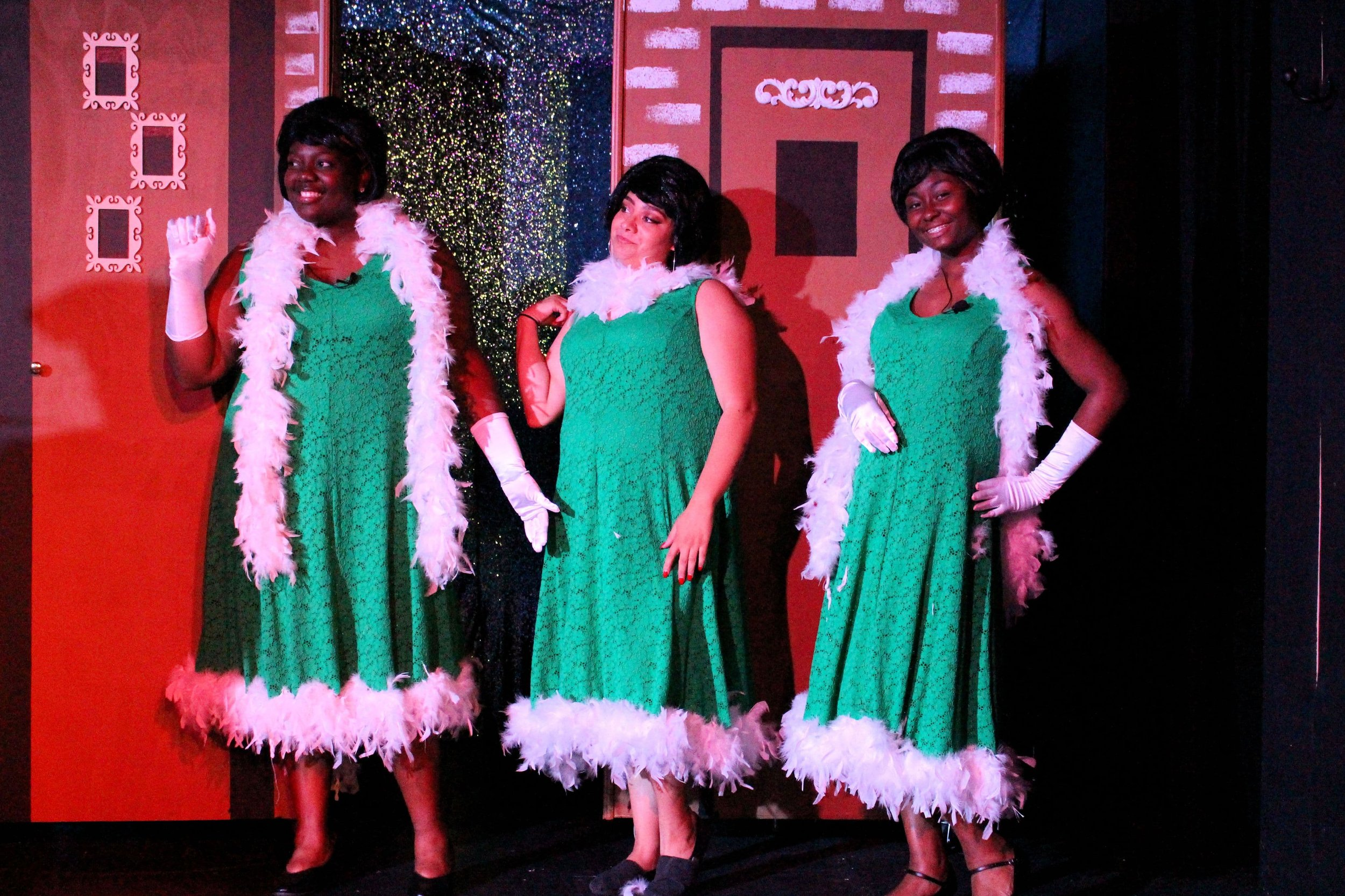 """Charity Gilbert, Laiyah Smith, and Jamila Wicker raise the roof as """"The Dynamites."""""""