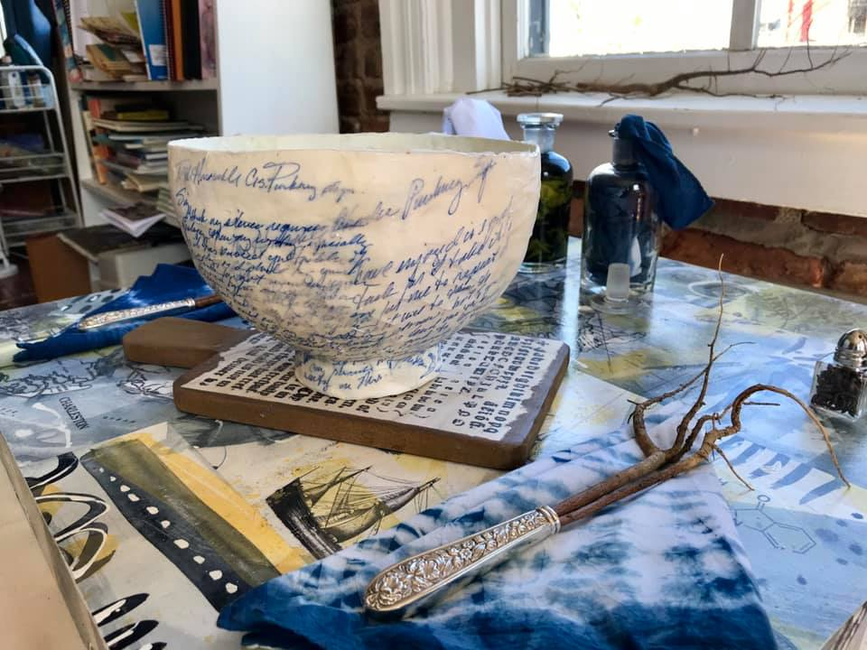 Laurie Brownell McIntosh's place-setting inspired by Eliza Lucas Pinckney whose development and cultivation of indigo accounted for 1/3 of colonial SC's economy prior to the Revolutionary War.