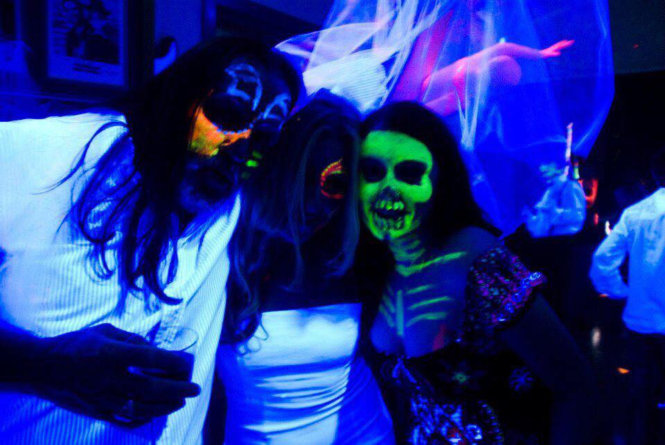 Chernoff (center) during an event Augustinova fondly remembers: a Halloween-themed black light party