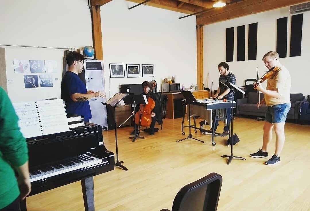 The Sandbox , located at  1806 W. Cuyler Ave . A bright workshop space steps from the train, perfect for rehearsals, recordings, and intimate recitals.