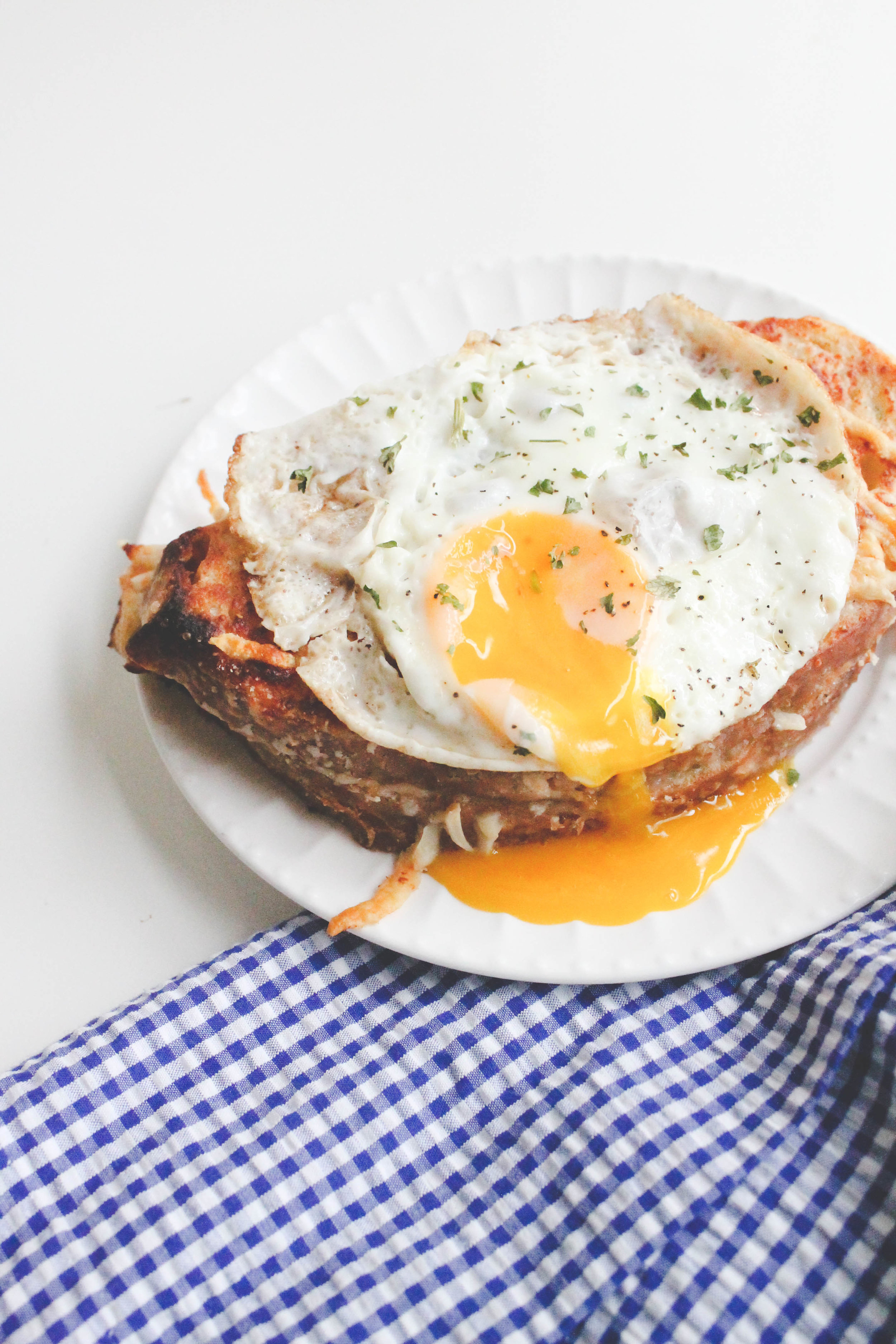 Croque Madame - A croque madame is the perfect brunch sandwich to absolutely wow your brunch guests. With thick slices of artisan bread, gourmet cheese oozing out of every corner and topped with a sunny side up farm fresh egg… this sandwich is the definition of delicious.