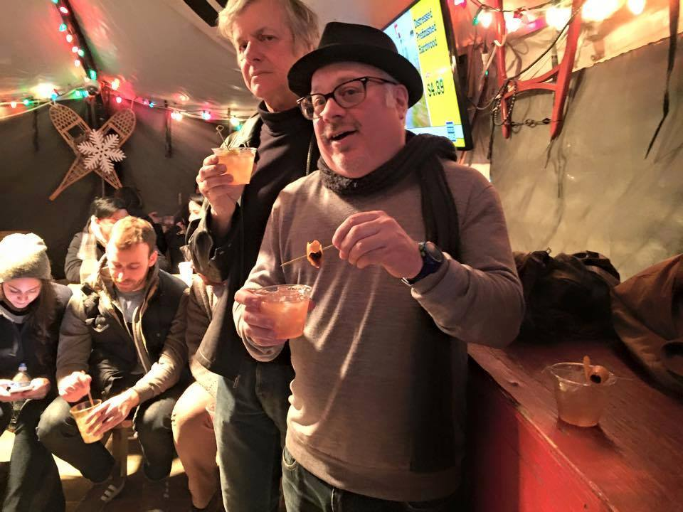 Mike Edison, host of long-running HRN show  Arts & Seizures , and behind him Peter Zaremba, a frequent show guest, at a Roberta's Tiki Tent event just outside the studio.