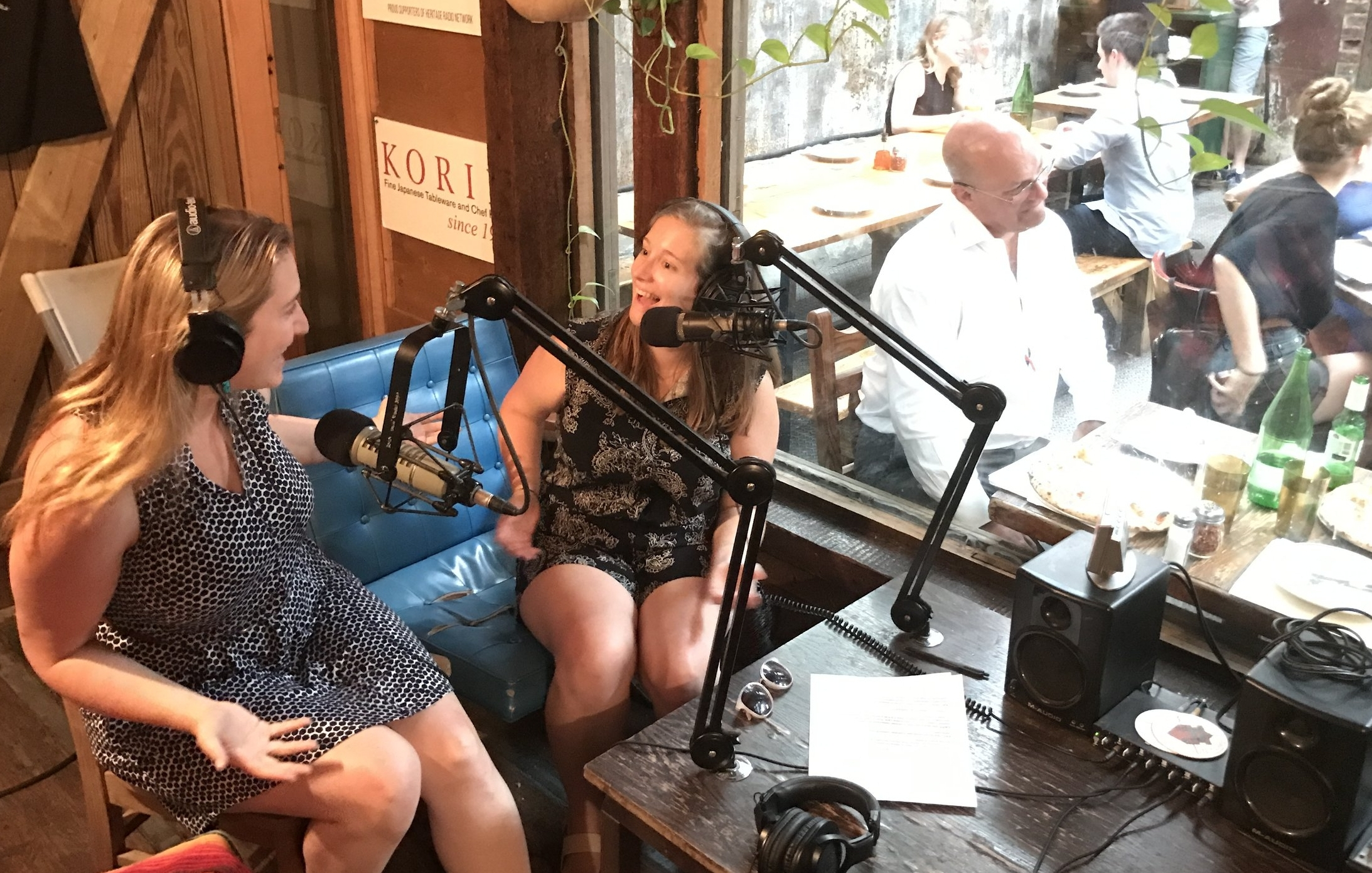 Executive Director Caity Moseman Wadler and Communications Director Kat Johnson hosting  Heritage Radio Network Happy Hour  with Roberta's just on the other side of the (shipping container) studio window.  (Photos courtesy of Heritage Radio Network)