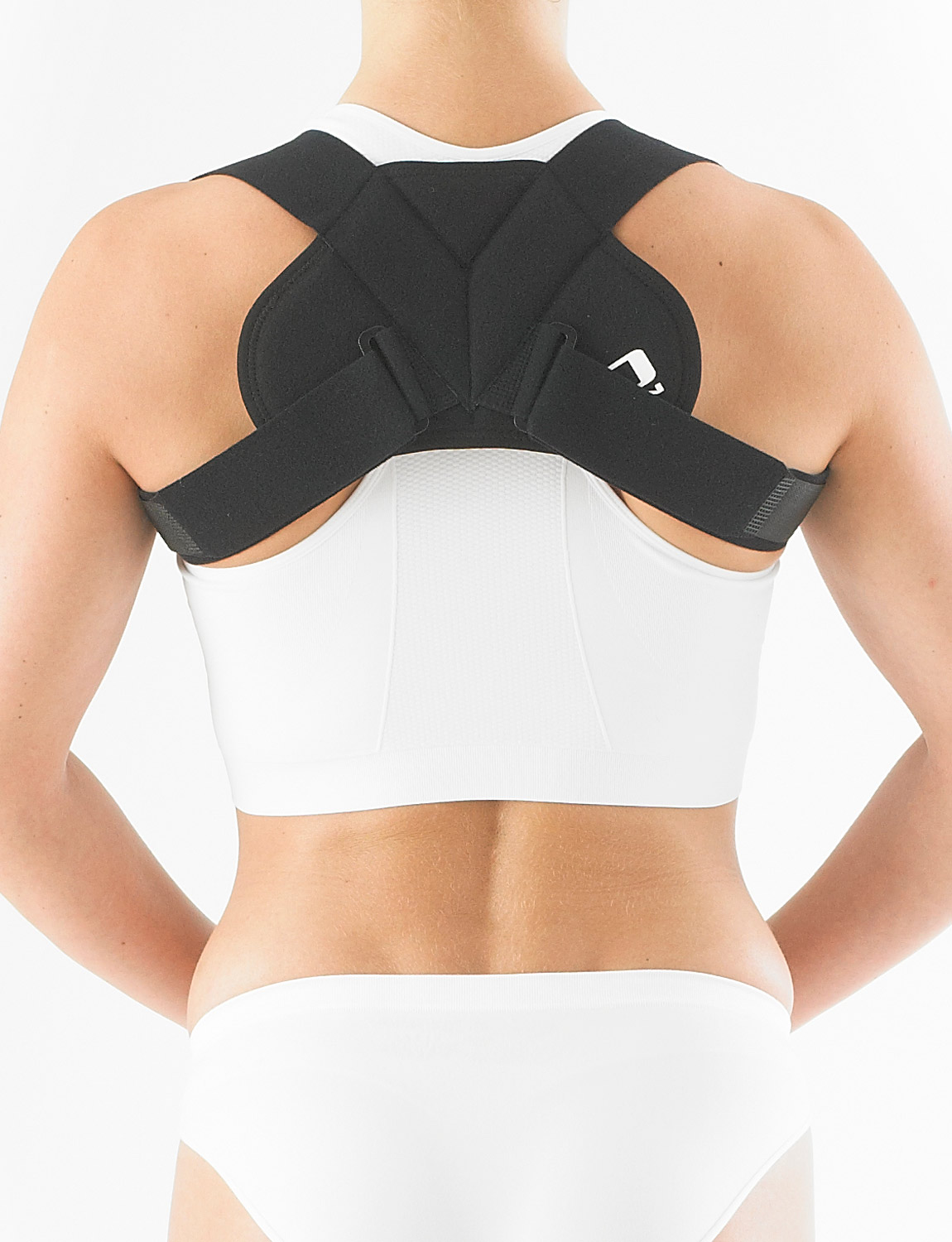 998 - LIGHT CLAVICLE/POSTURE SUPPORT  Designed to assist with the correction of poor posture and rounded/slumped shoulders. Providing stabilization to the clavicle area, the device is placed around the shoulders and secured with the fasteners for a comfortable and supportive fit. It helps correct postural alignment of the dorsal spine by encouraging the shoulders to pull back.