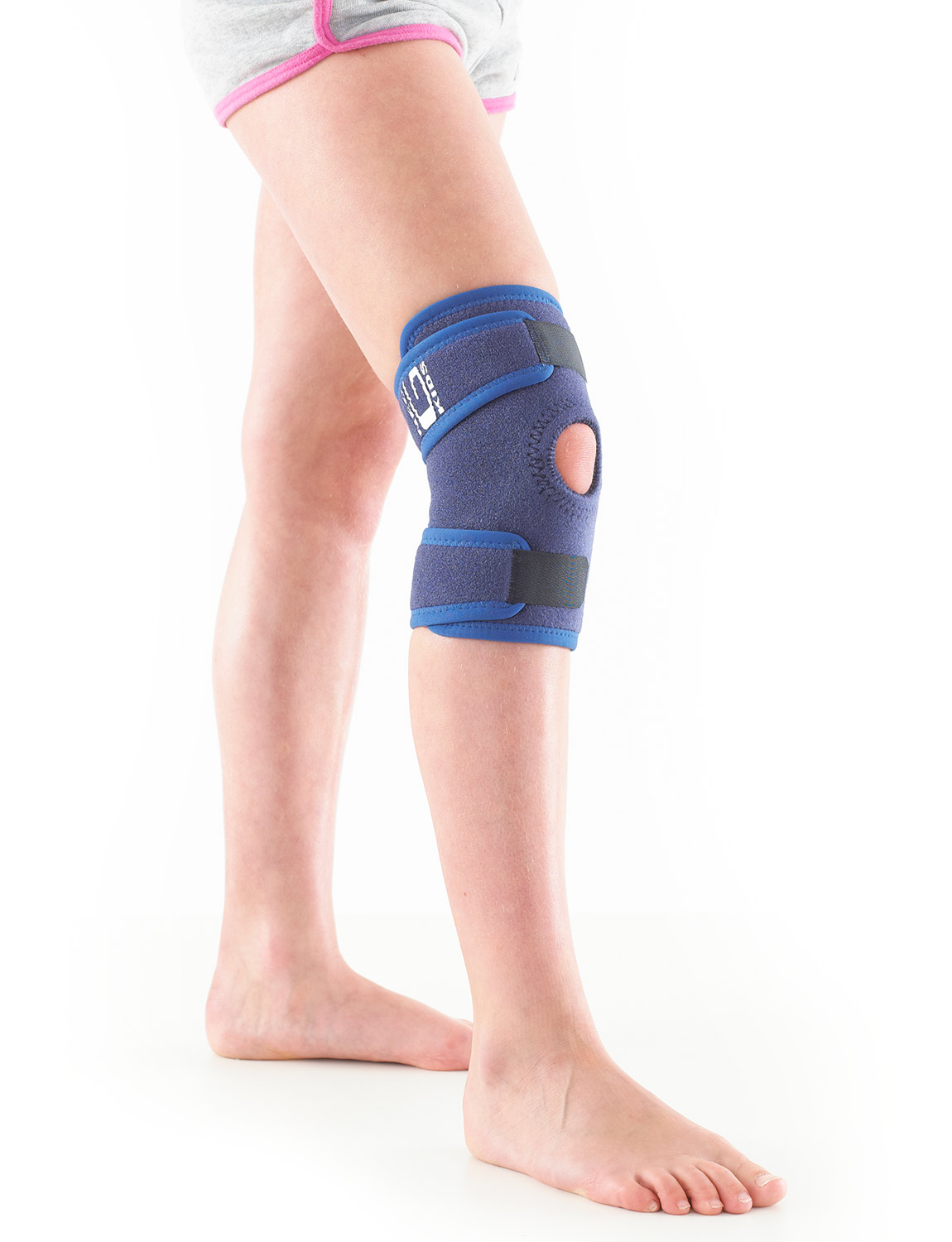 885K - KIDS OPEN KNEE SUPPORT  Specifically designed for the younger wearer and offers dynamic support and adjustable compression to the knee complex without restricting movement. The open patella design with stitched buttress helps with patellar tracking whilst providing added support and helping with overall stability by eliminating glide and twisting at the knee. Weight bearing pressure during movement is more evenly distributed over the joint helping with arthritic and meniscus pain. The durable, heat therapeutic neoprene helps with juvenile arthritis, chronic aches and stiffness.