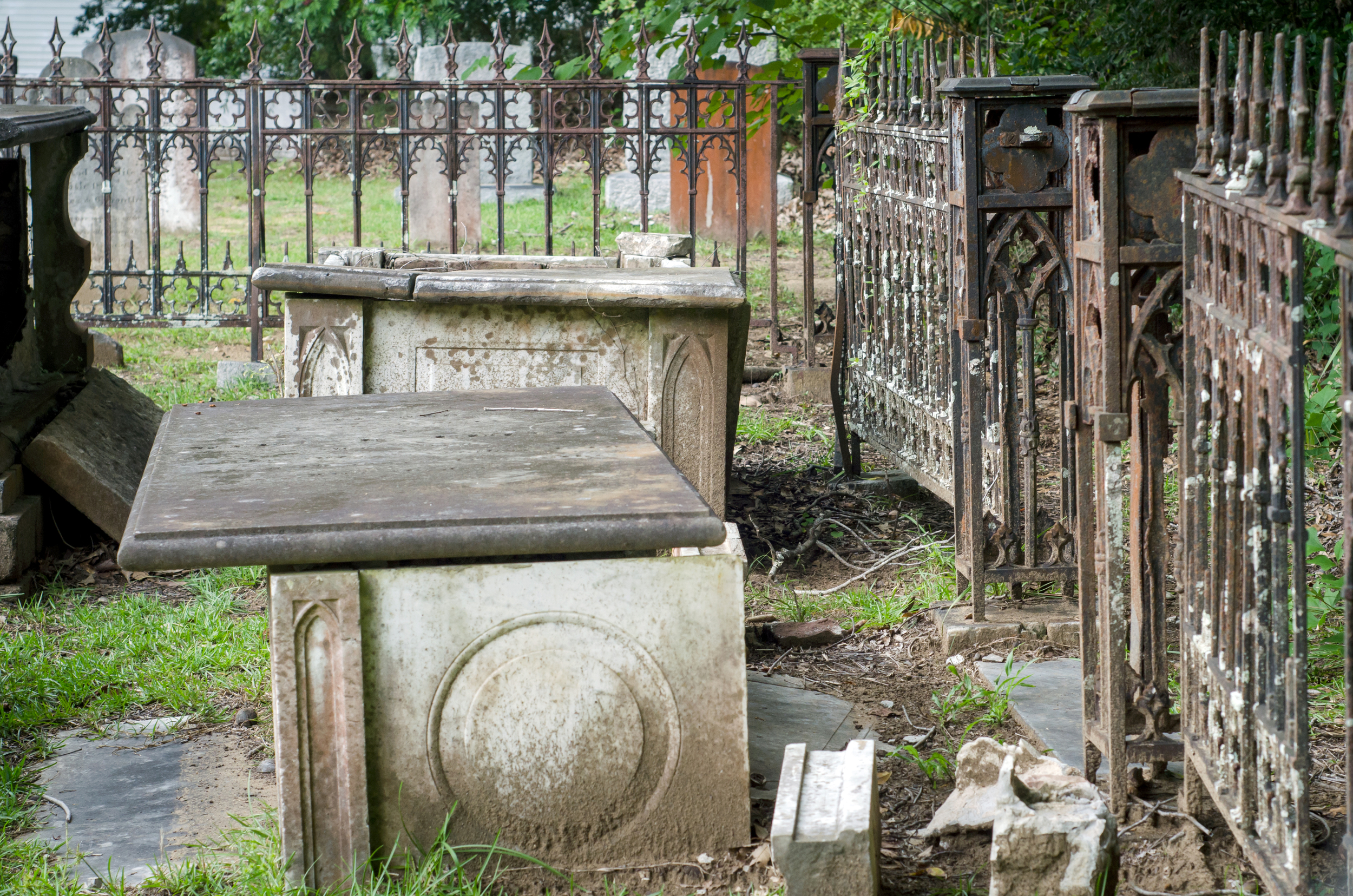 A scene of an above ground tomb and wrought iron gate in the cemetery at The Presbyterian Church on Edisto Island.