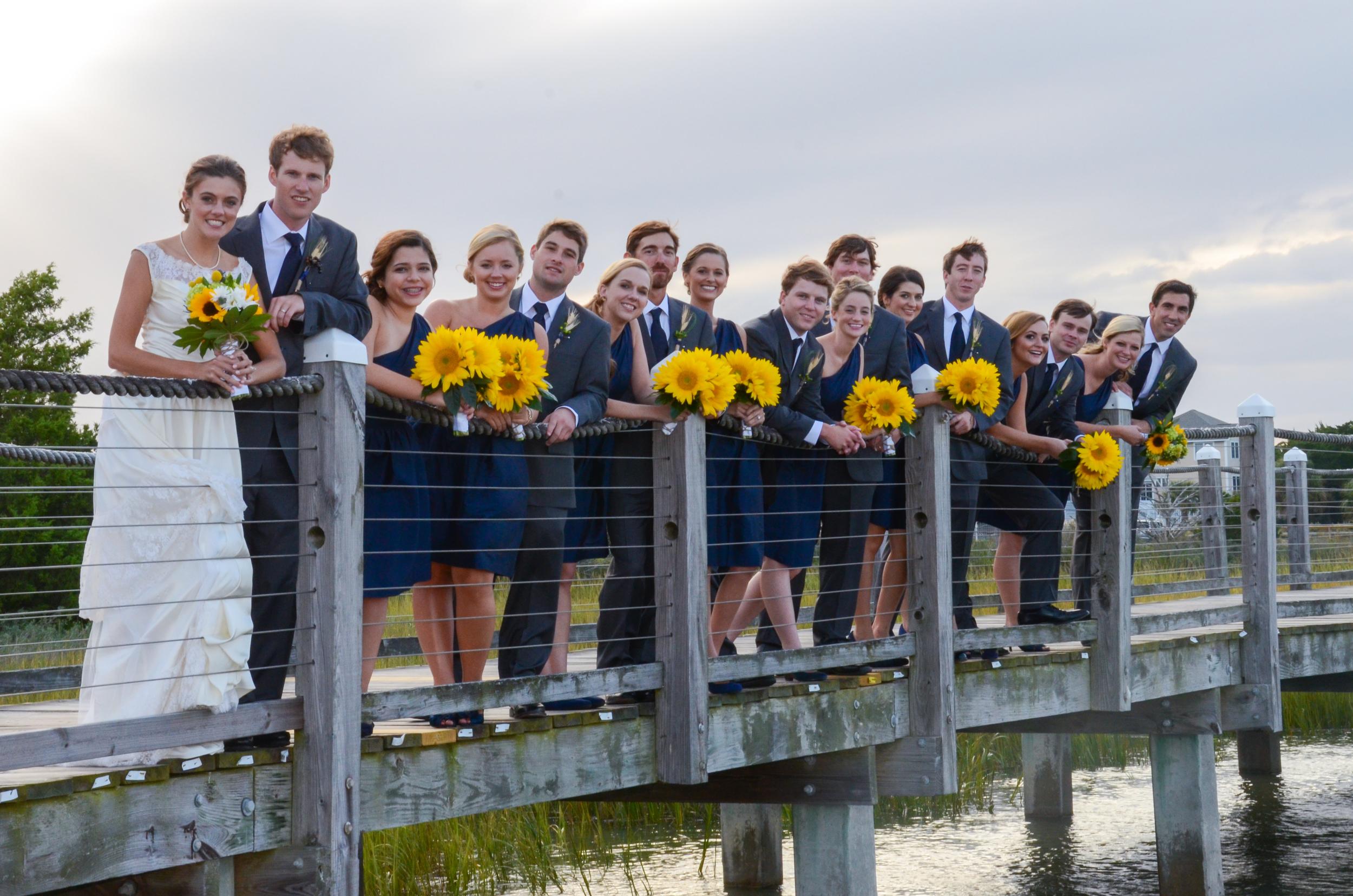 Bride, groom and bridal party on dock at the Marina at Edisto Beach.