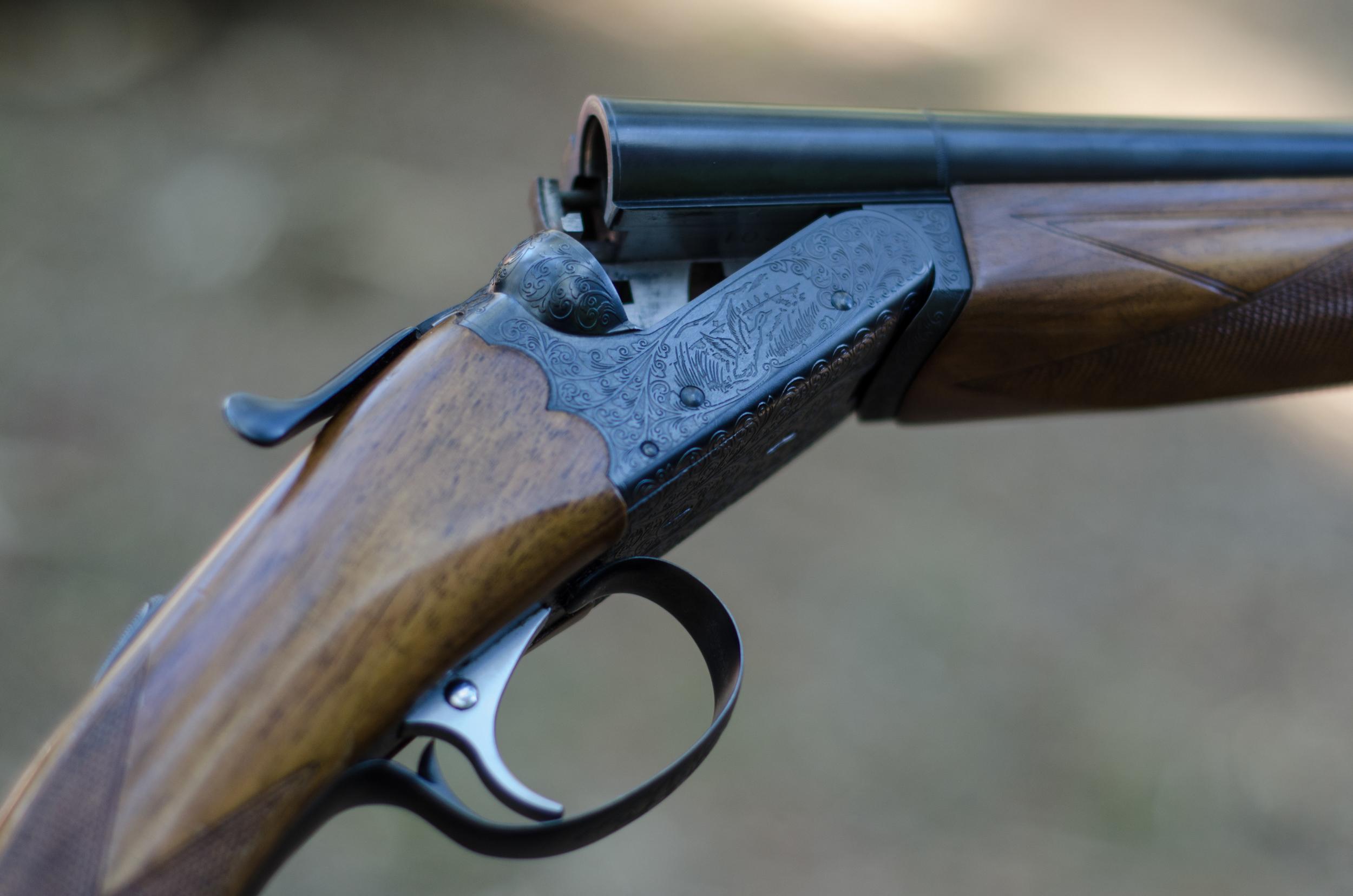 Intricate details on a 20-gauge shotgun.