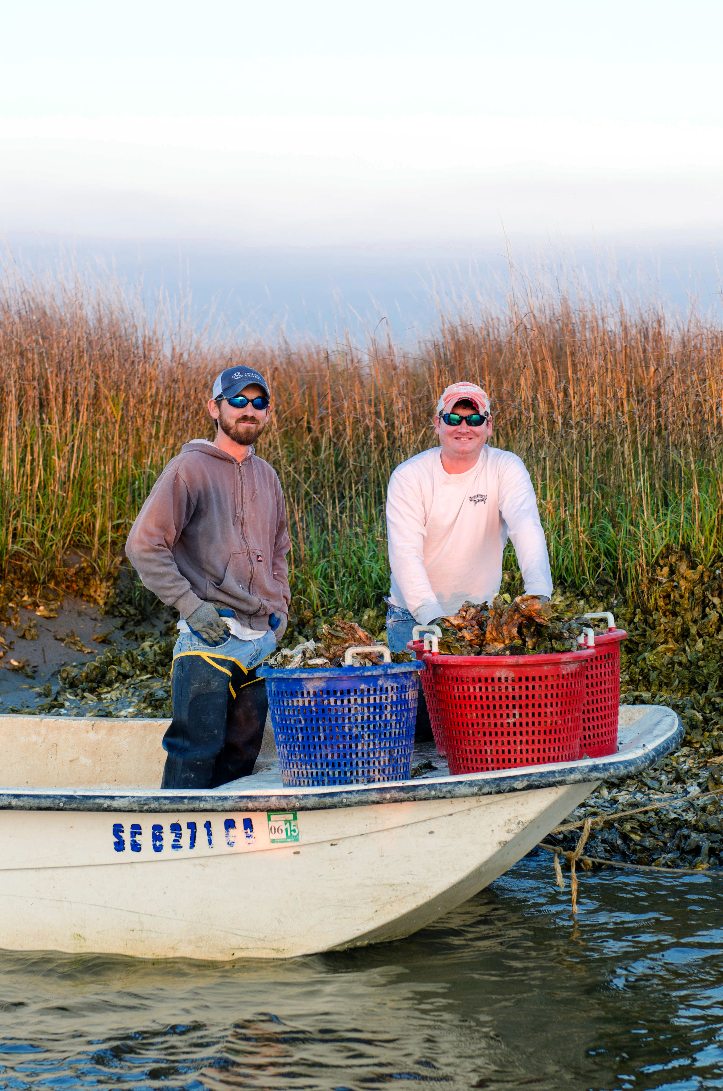 Jimmy Skinner & Ashley Fontaine collecting oysters in the waterways of Edisto Island.