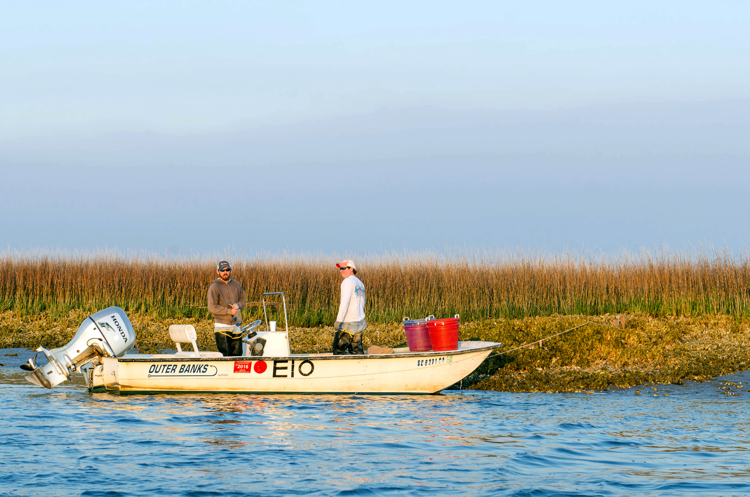 Jimmy and Ashley anchored to an oyster bed, Edisto Island, SC.