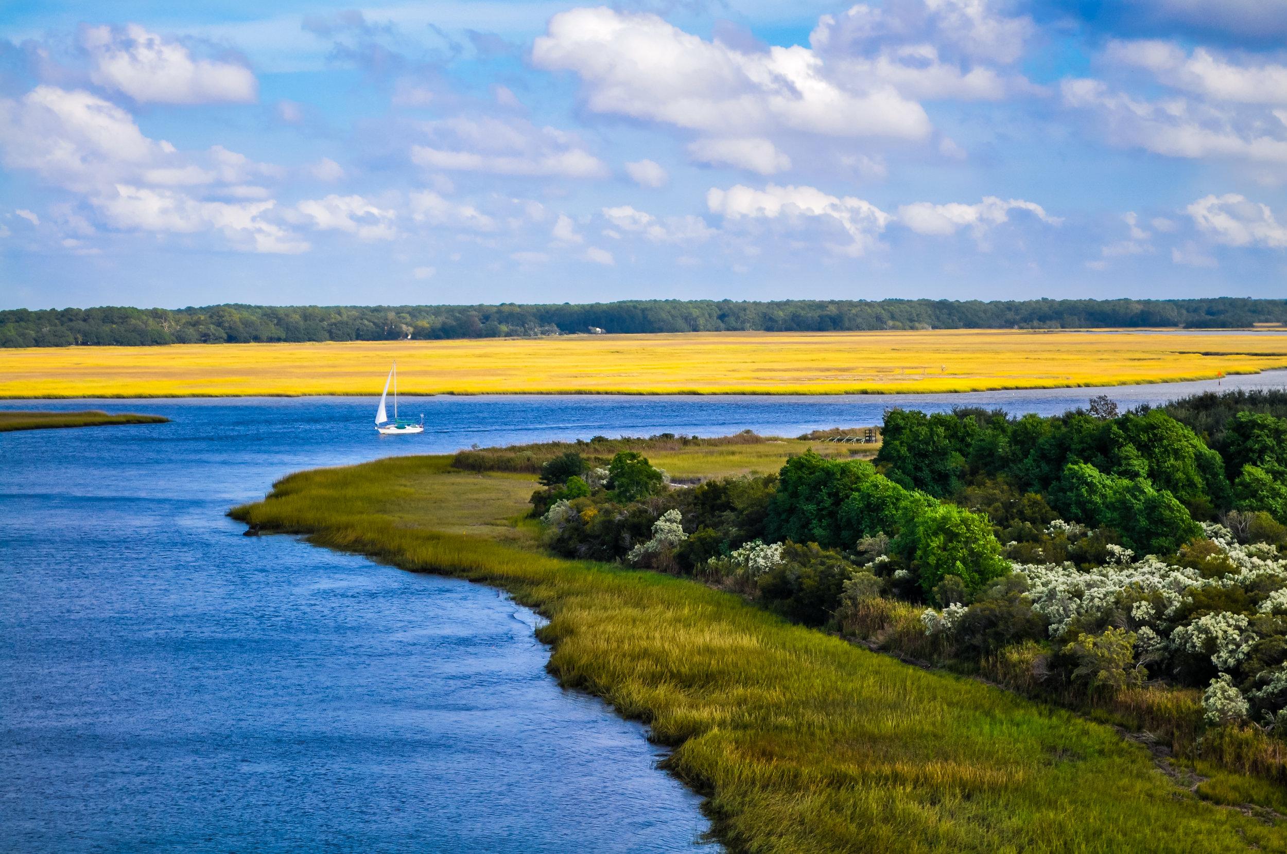 Colorful view of sailboat in creek at Edisto Island, SC.