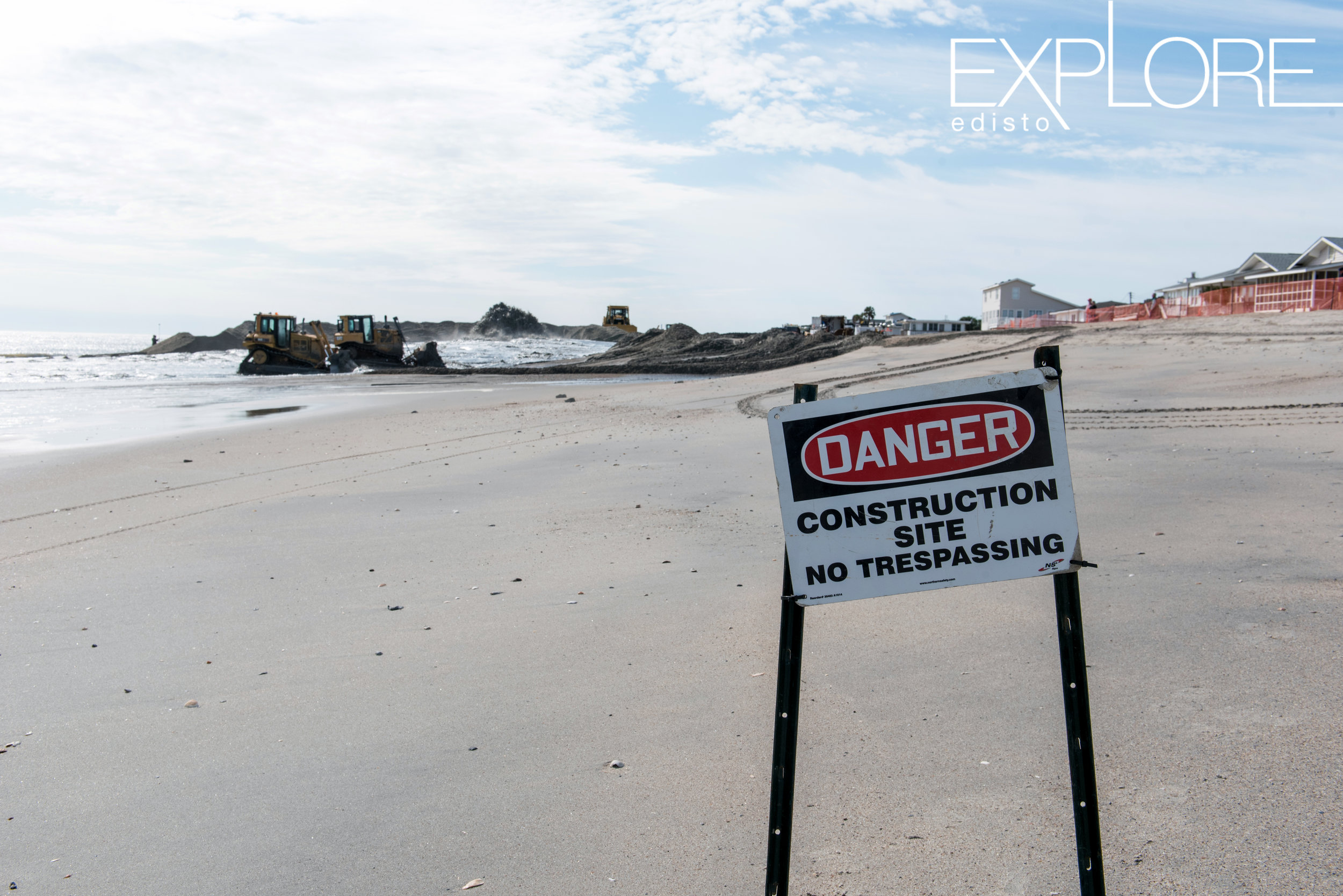 Danger, Construction Site sign on the beach in front of beach nourishment work site.