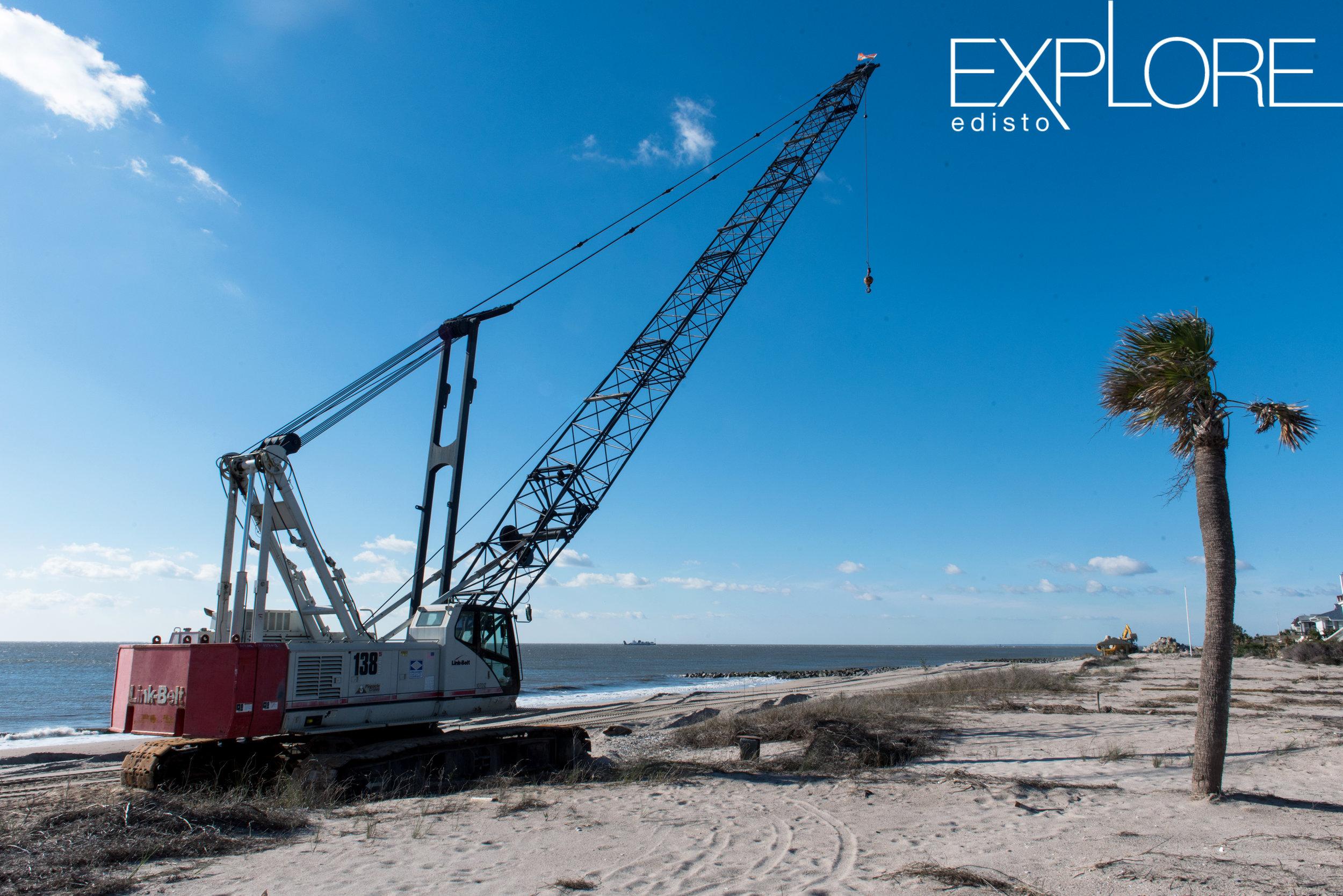 Crane on beach during beach renourishment.