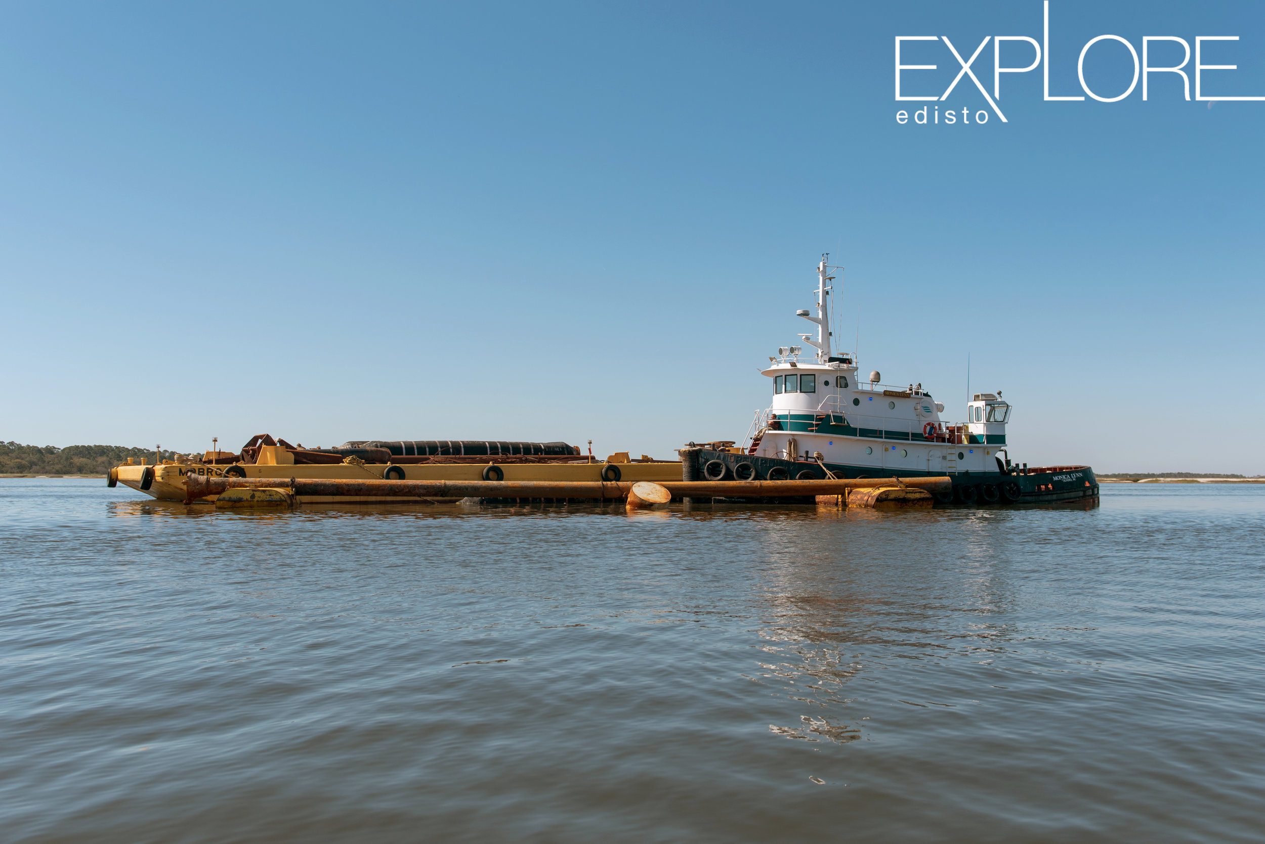 Barge and freight on the water during beach renourishement.