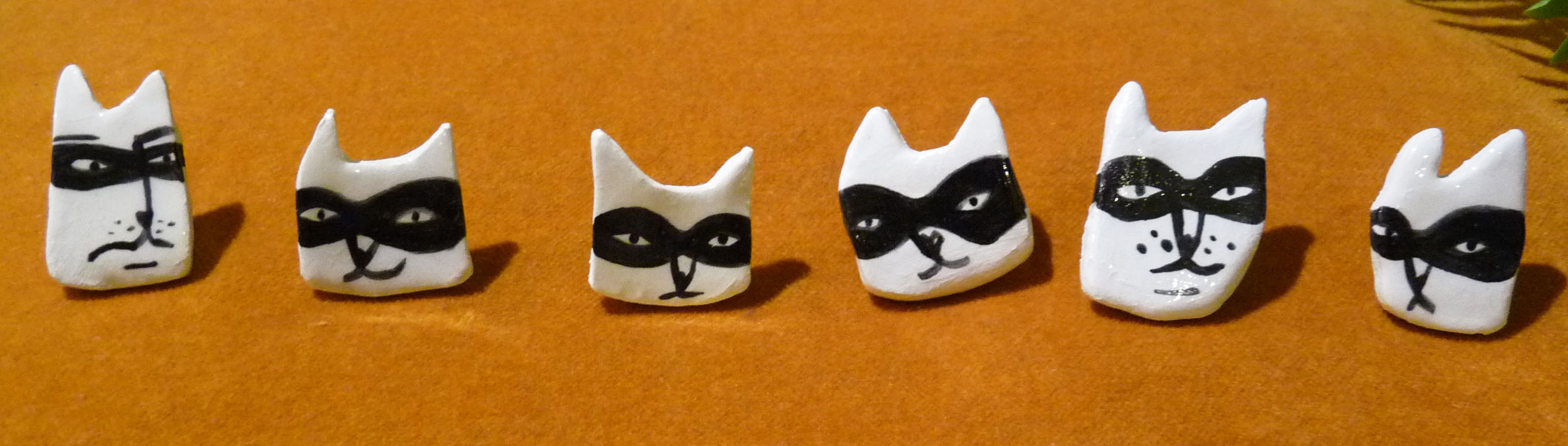 Find pins, prints and other ceramics and textiles on my shop!