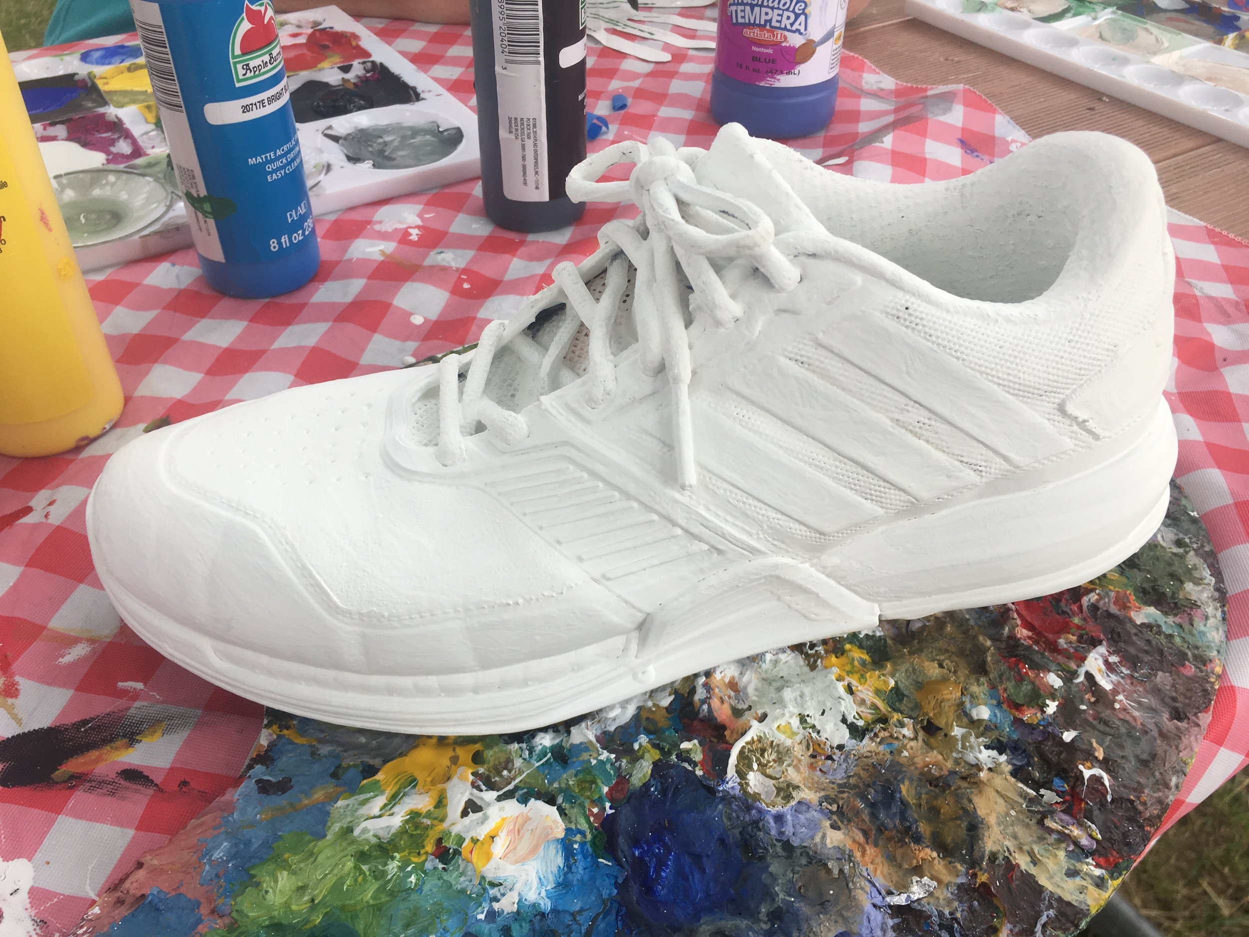 Step 2: Prime shoe with gesso. This not only makes it an easier surface to paint on, but for tricky areas like the laces it kind of acts like a glue.
