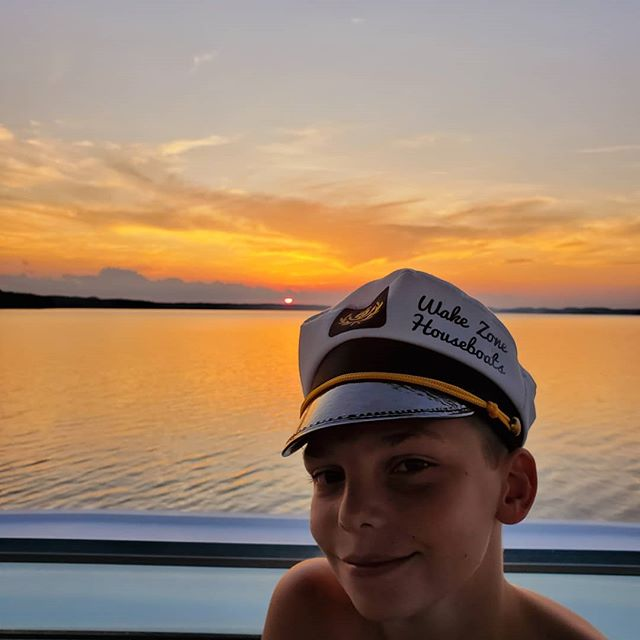 Captain (in training) Porter sunset cruising! #wakezonehouseboats #lakeouachita #arkansas