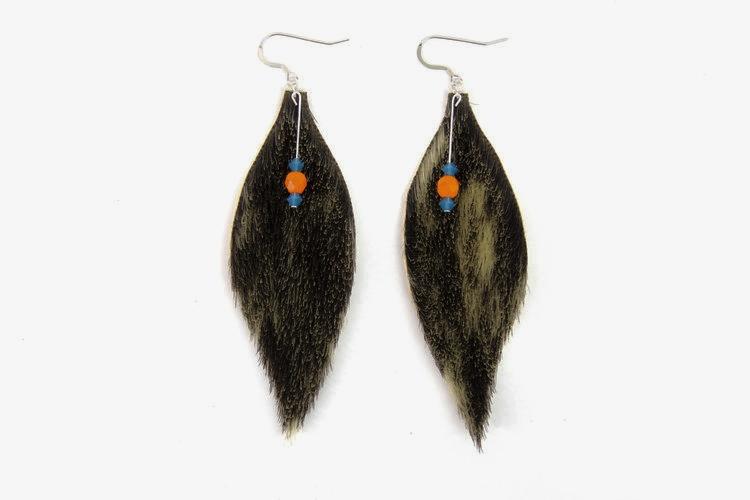 """ floating feather seal fur beads earrings "" from Alaska Native designer Peter Paul Kawagaelg Williams' fashion label  Shaman Furs . Copyright Shaman Furs."