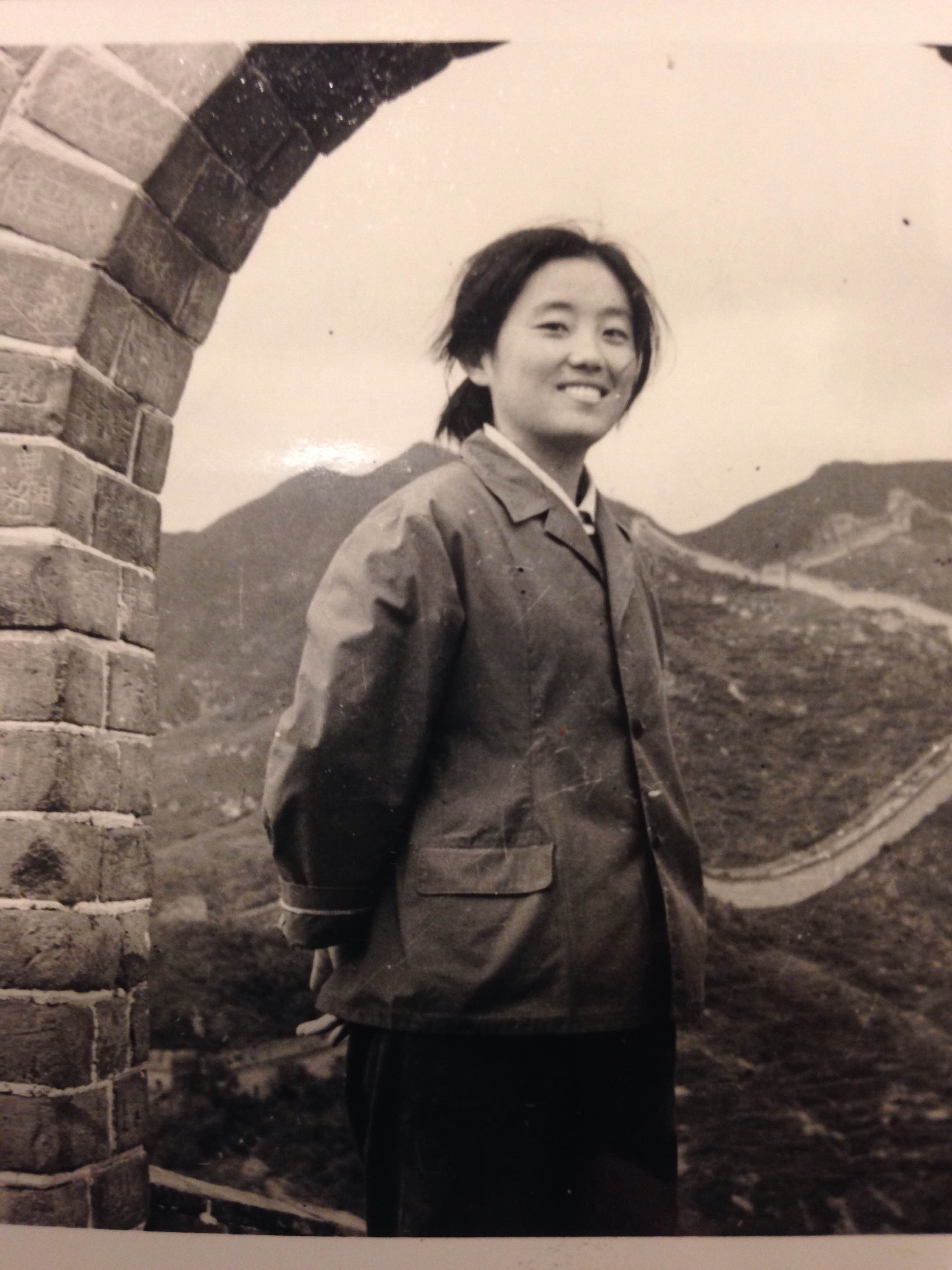 Elena's mom in Mao-era China, standing on the Great Wall. Image courtesy the author.