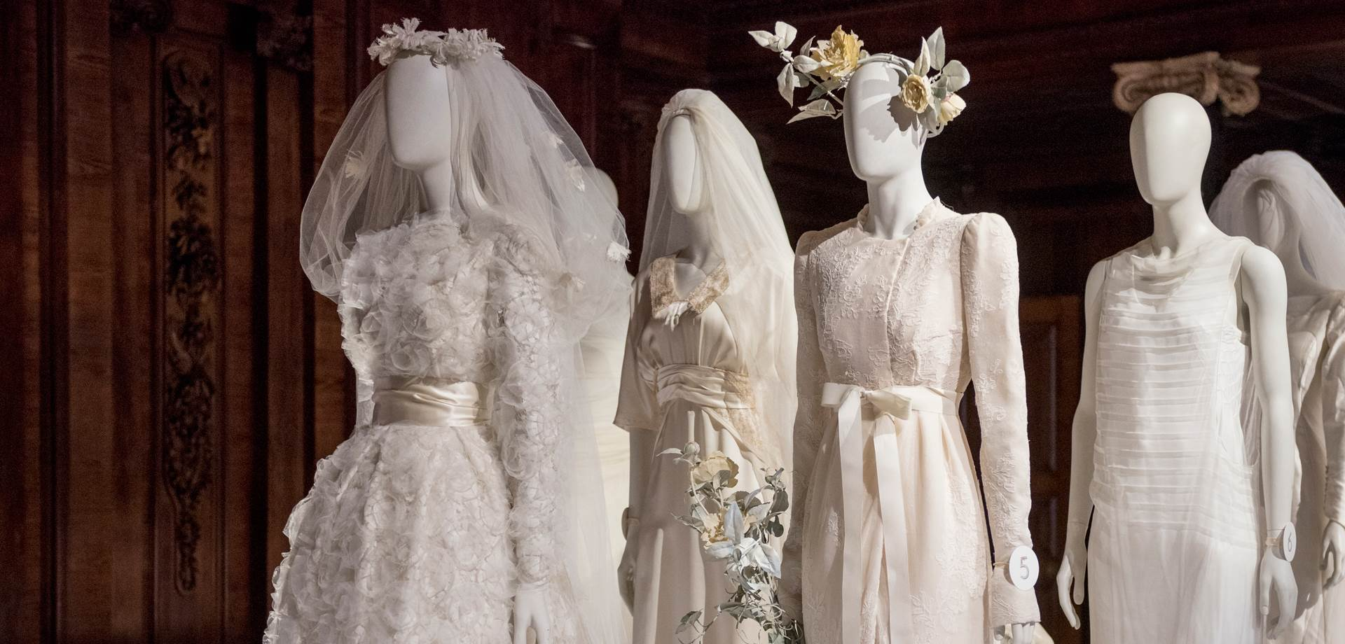Four wedding  worn  at family weddings displayed in the estates chapel. Image courtesy of Chatsworth Trust.