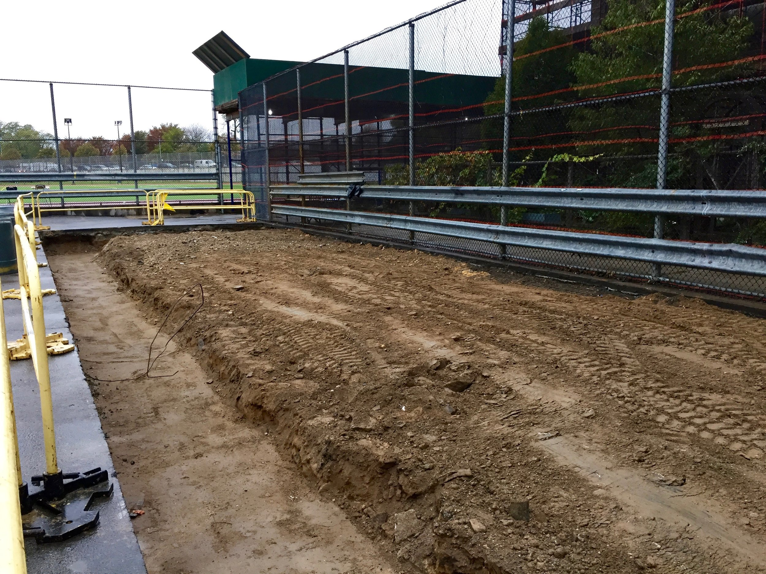 Behind the fence is the school's first garden site, which will nearly double in size after this excavated area has been finished.