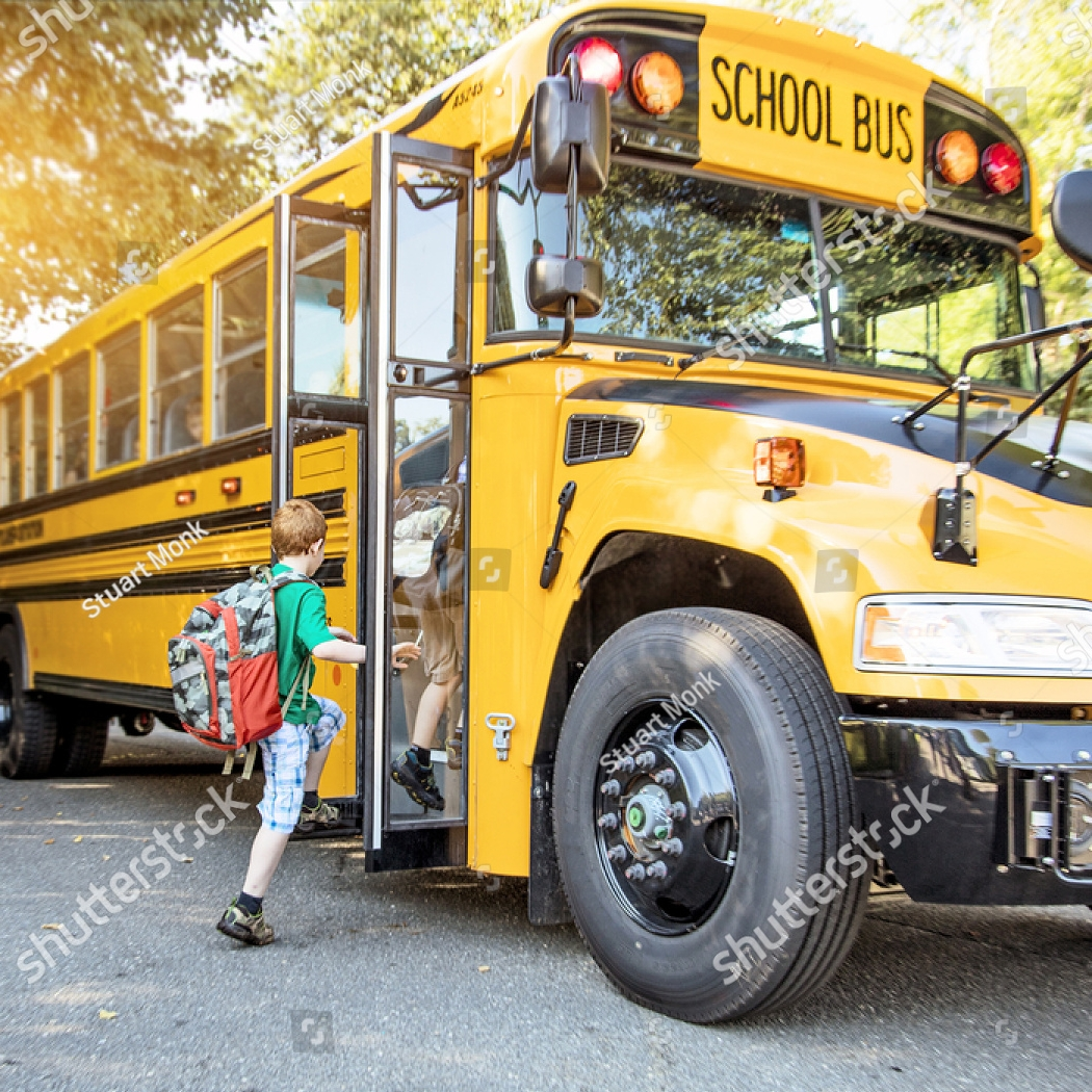 stock-photo-a-group-of-young-children-getting-on-the-schoolbus-314871770.jpg