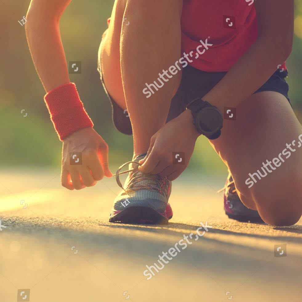 stock-photo-young-fitness-woman-runner-tying-shoelace-before-run-on-morning-tropical-forest-trail-657446608.jpg