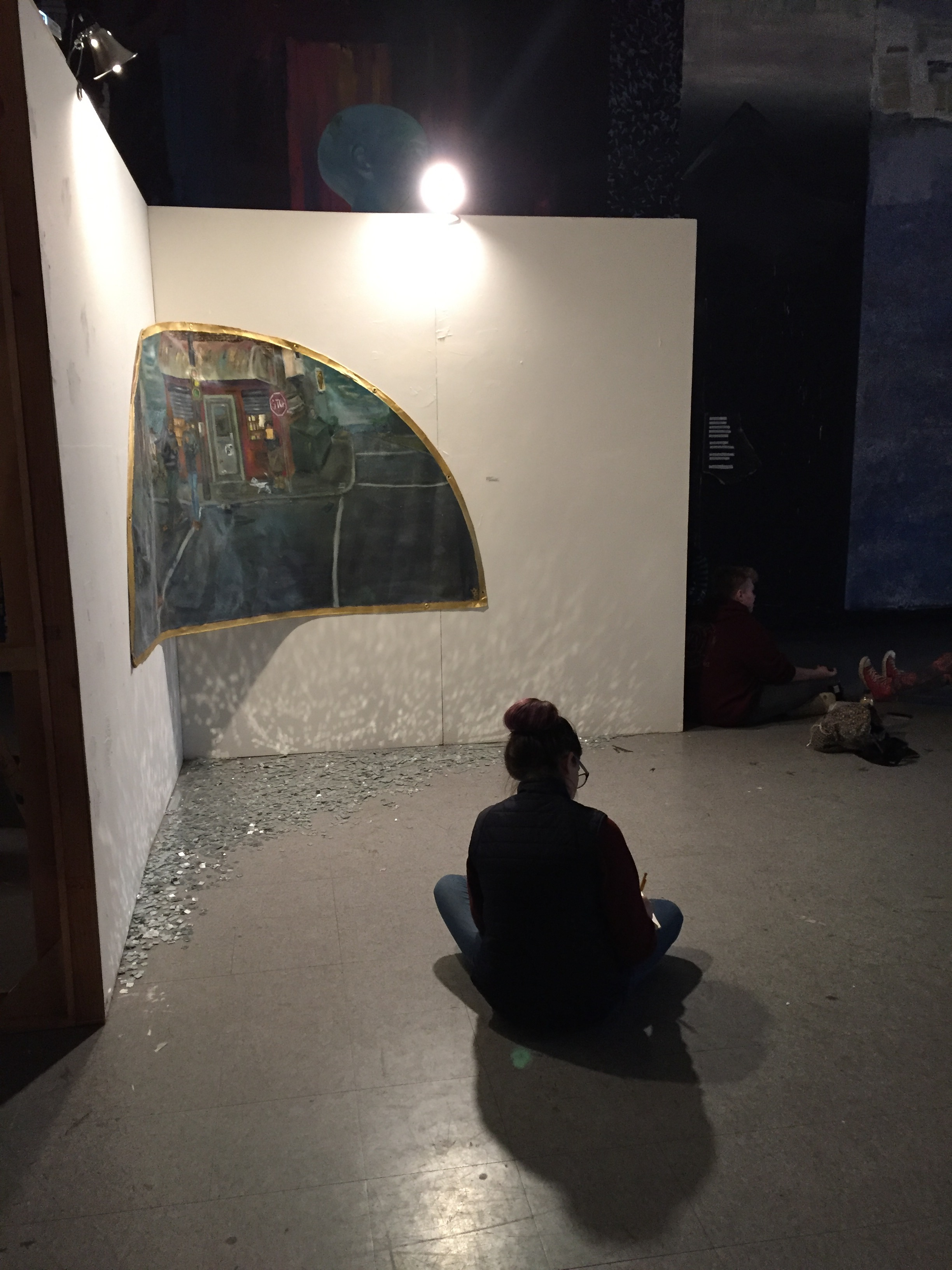 Jenna (IDEA '20) journaling about one of the pieces at Colored.