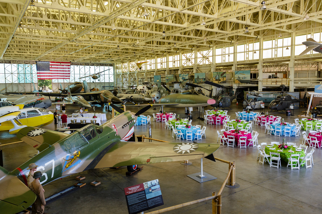 Colorful lunch tables set  amongst the fighter planes